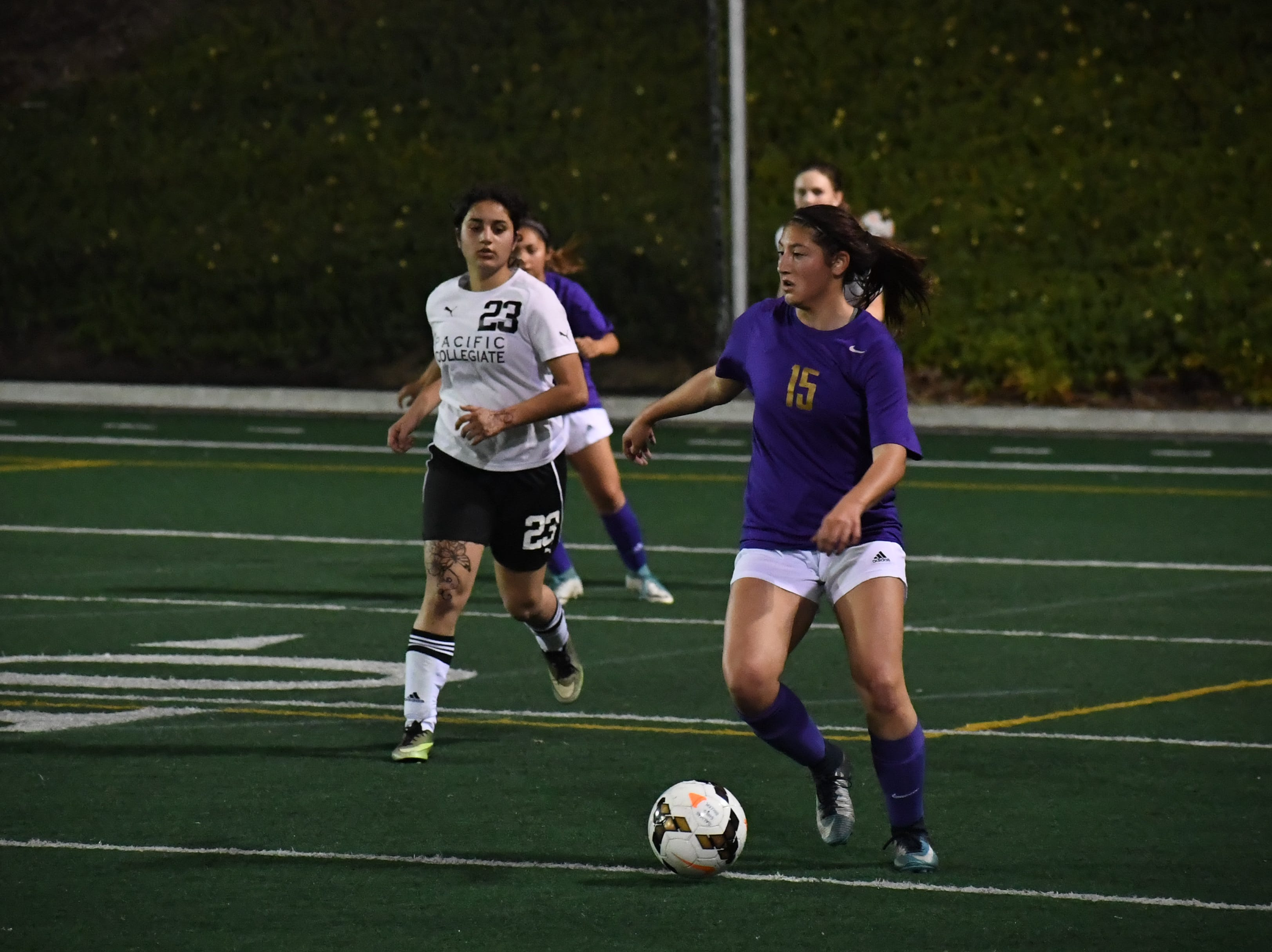 Junior Jordyn Magno (15) looks to pass after corralling a throw-in.