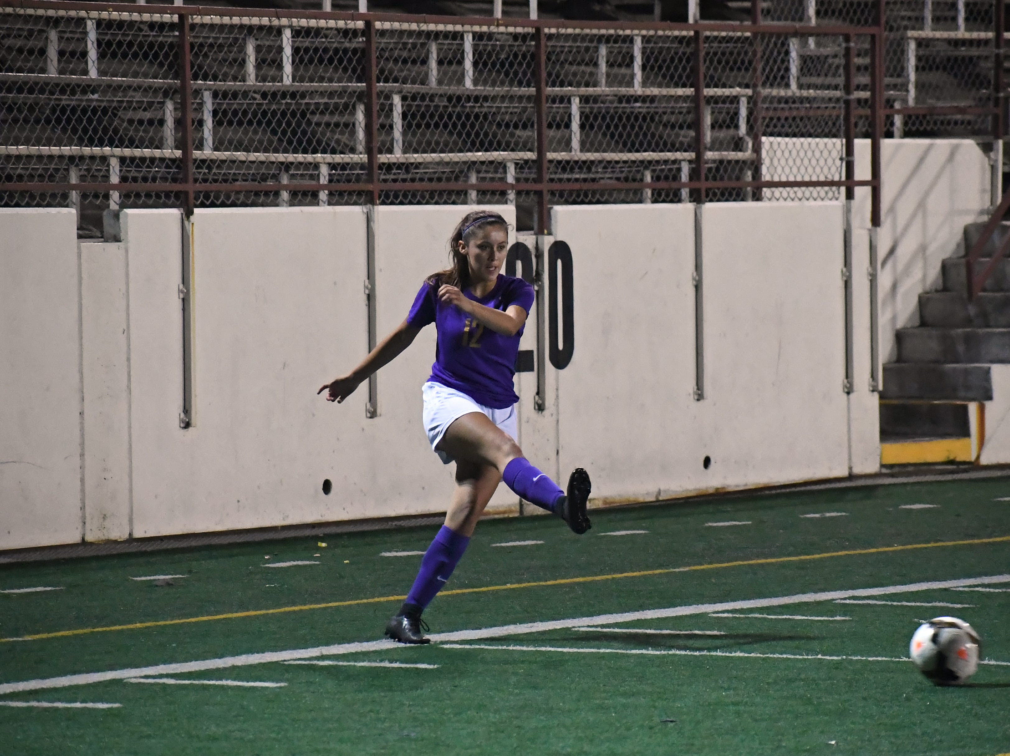 Junior Victoria Pelagio (12) fires a pass toward the center of the field.