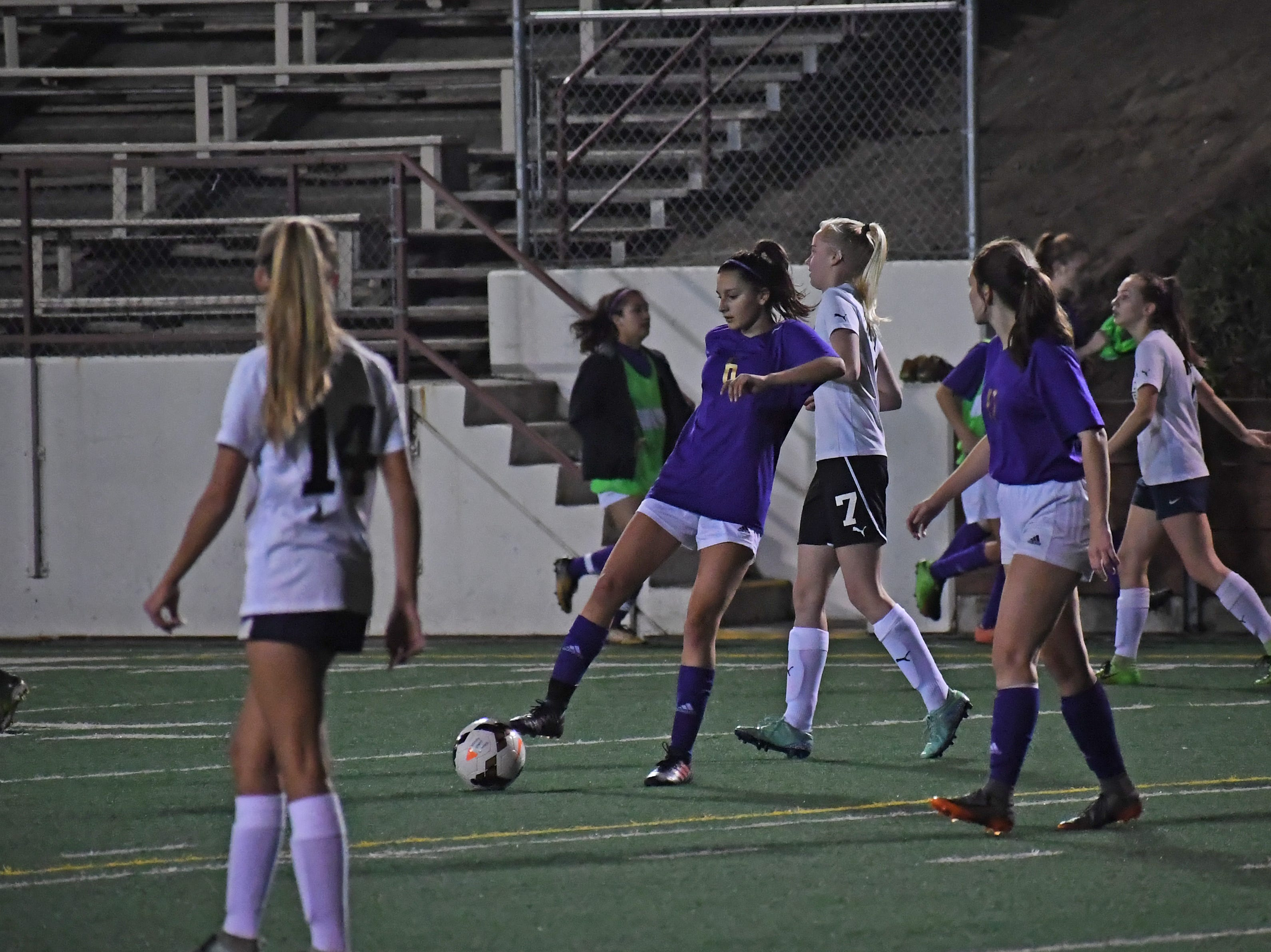 Junior Vivianne Mendoza (6) sets up the ball for a free kick.