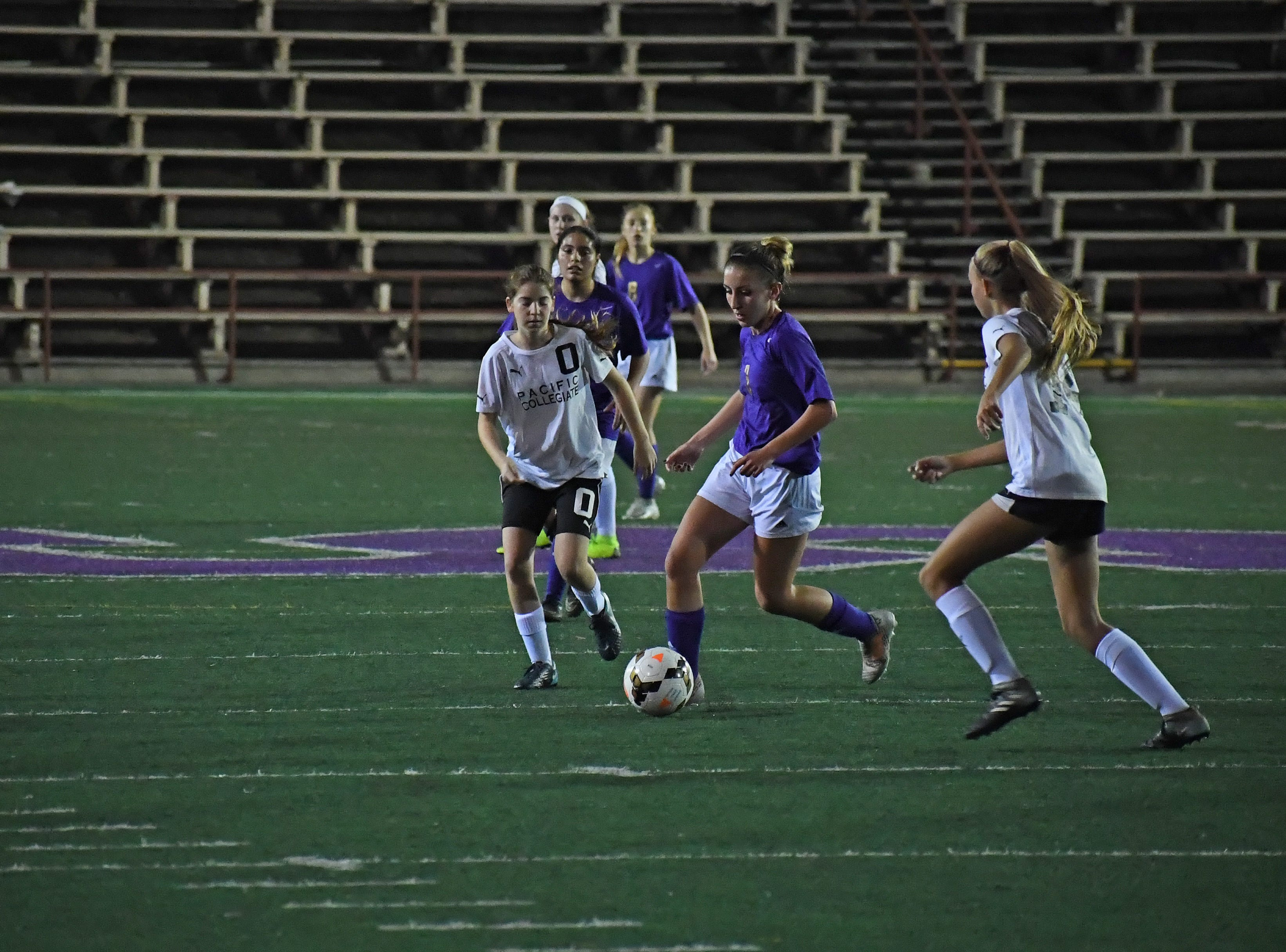 Sophomore Camryn Garcia (3) splits the defense.