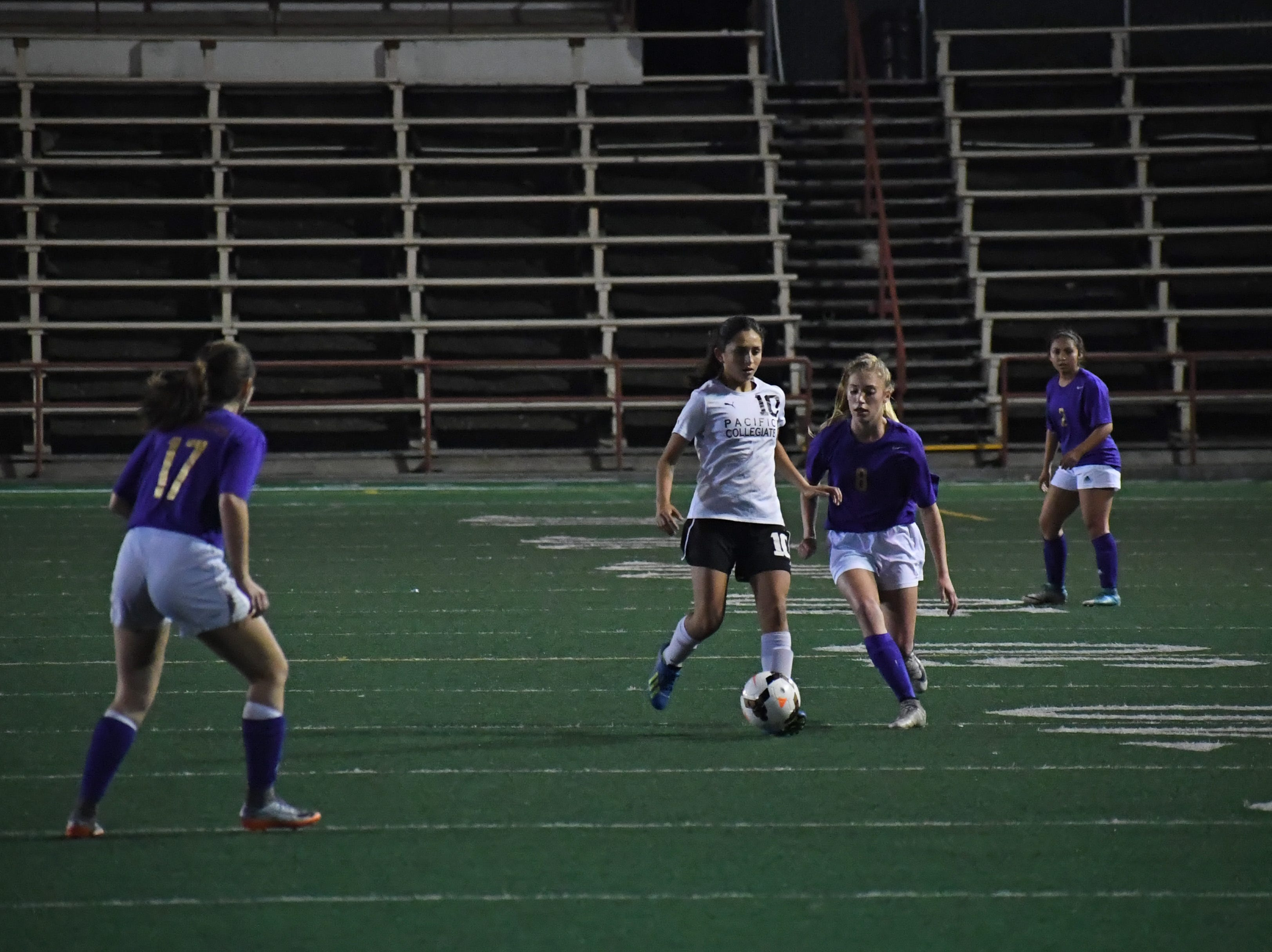 Freshman Taylor Freitas (8) tries to gain possession in the second half.