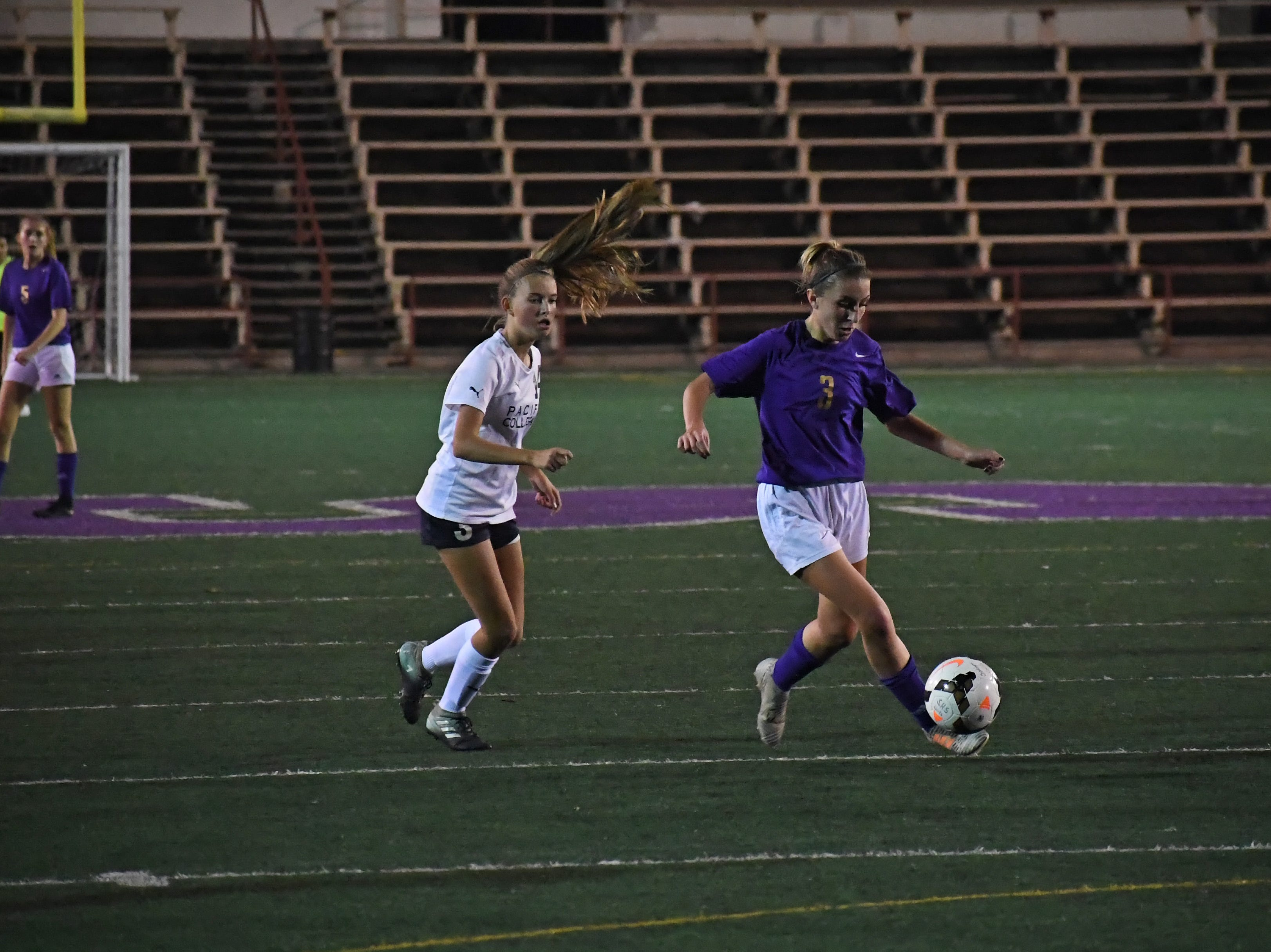 Sophomore Camryn Garcia (3) intercepts a pass and dribbles upfield.