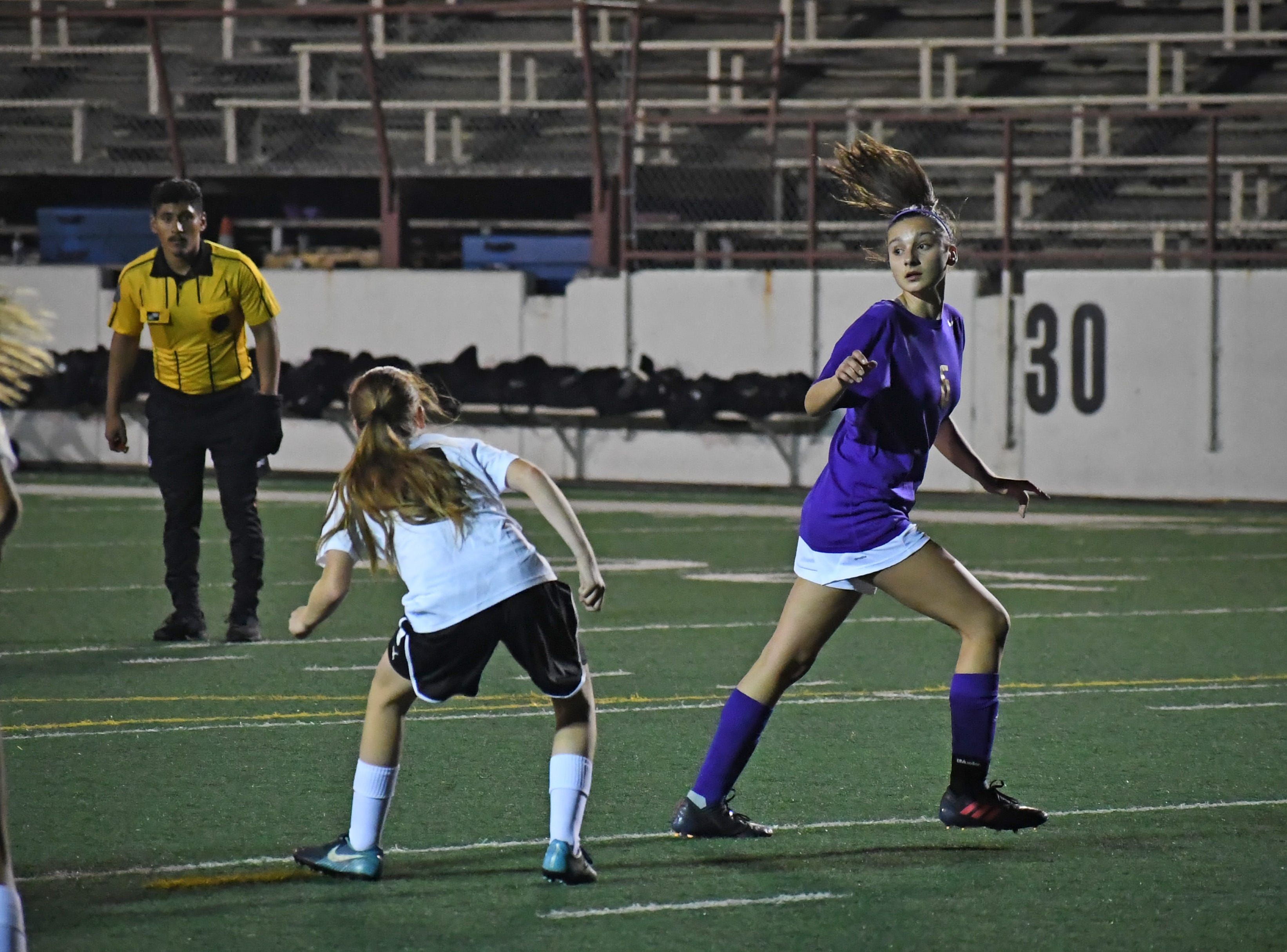 Junior Vivianne Mendoza (6) looks to see where a corner kick lands.