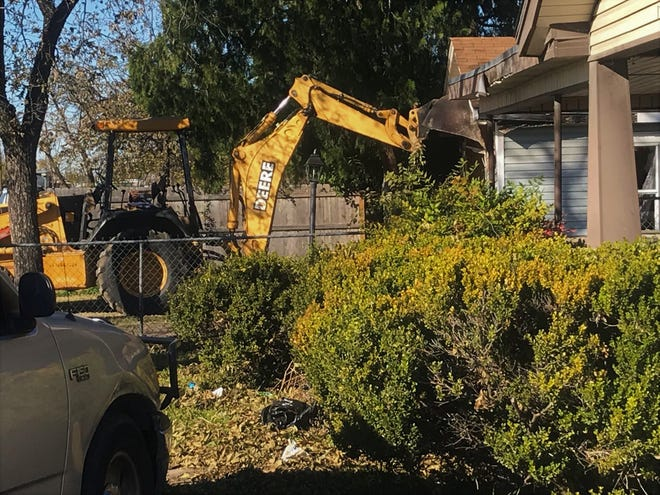 San Angelo Police have arrested one person after a bulldozer began tearing into a house on East 19th Street.