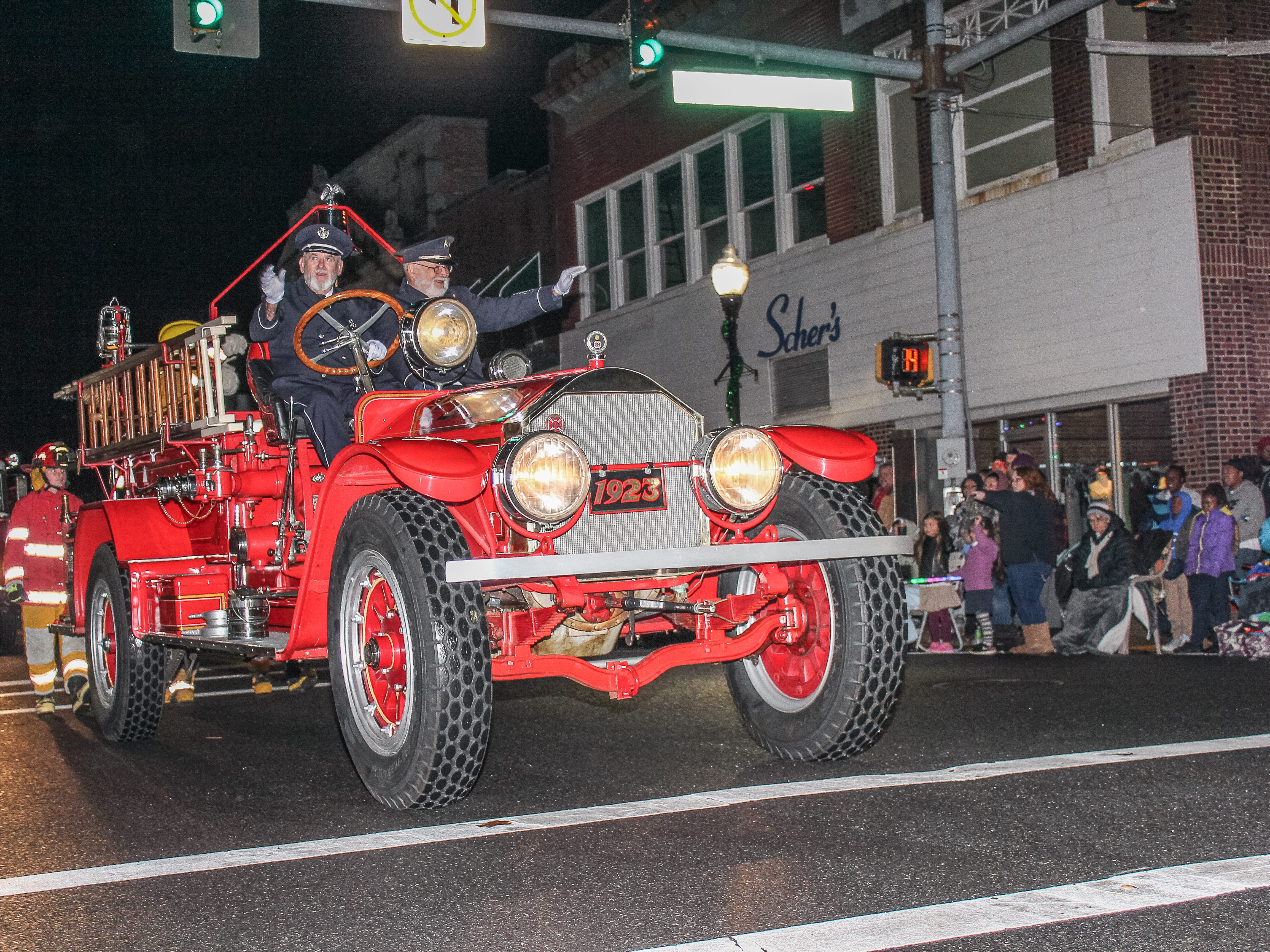 A vintage Pocomoke City Fire Company truck takes part in the annual Pocomoke Christmas Parade on Nov. 26. Several hundred peopled turned out to watch the Eastern Shore tradition despite rain.