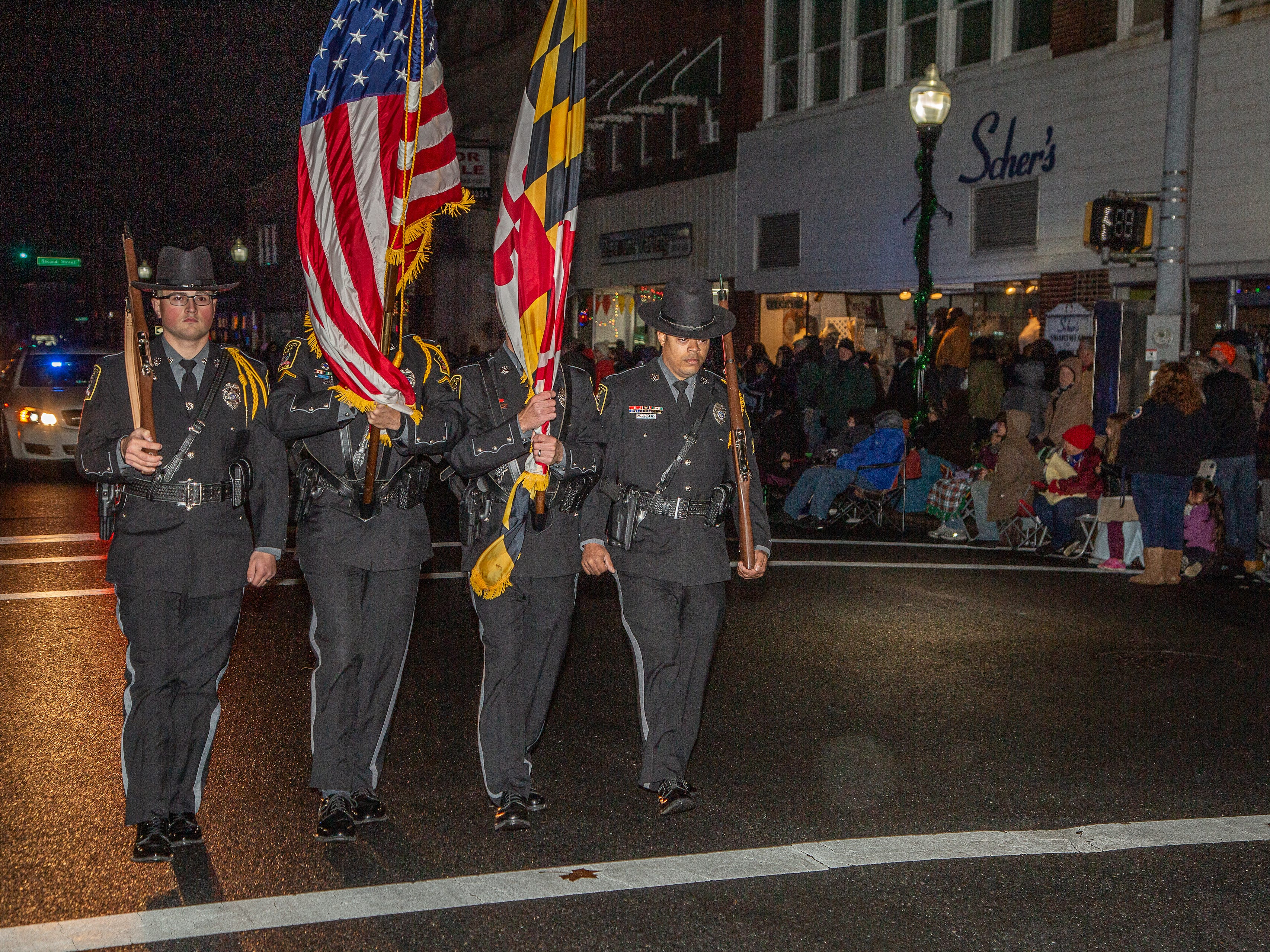 Pocomoke City Police Honor Guard marches in the town's Christmas parade.