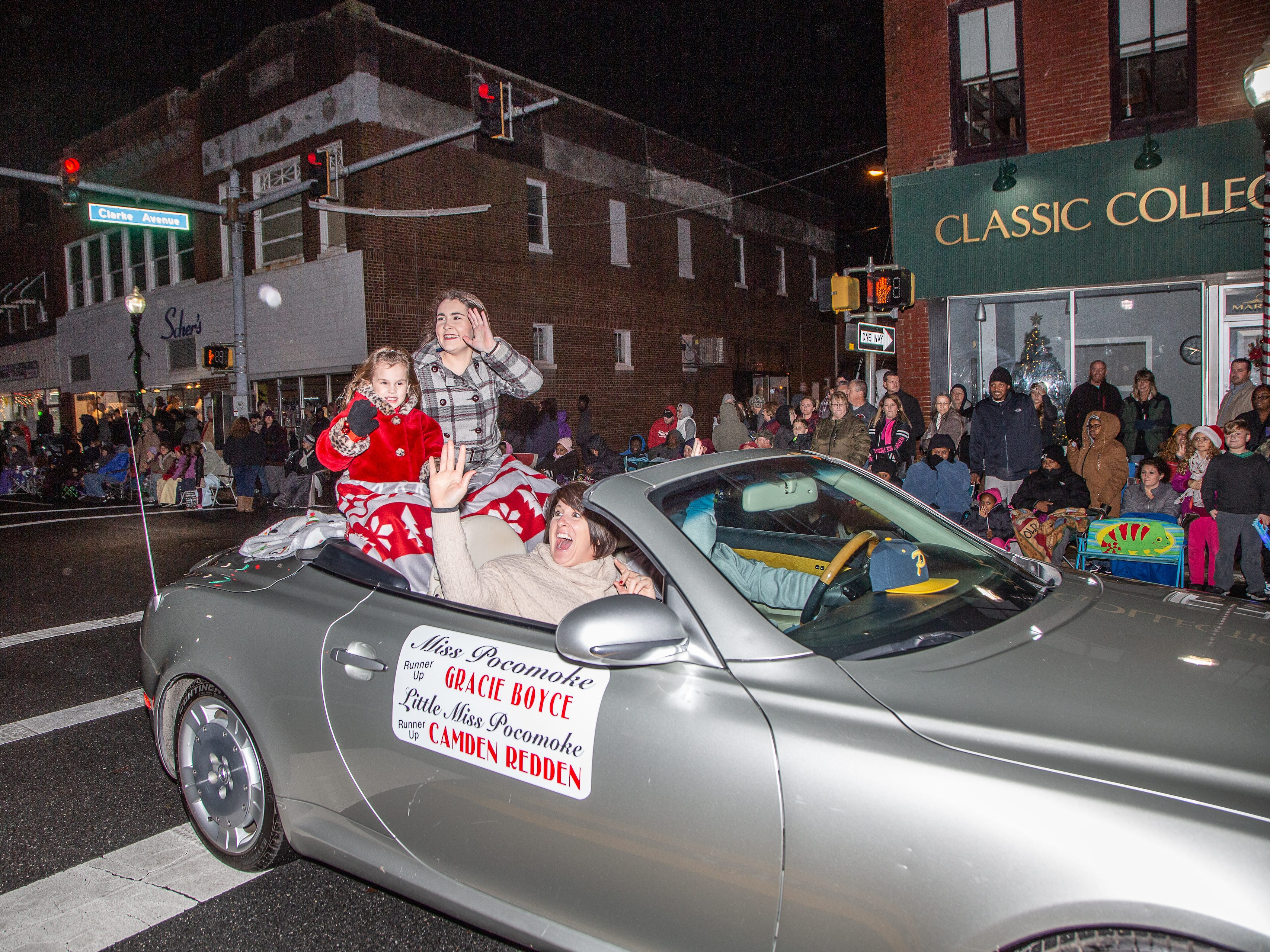 Miss and Little Miss Pocomoke wave to the crowd during the town's annual Christmas parade.
