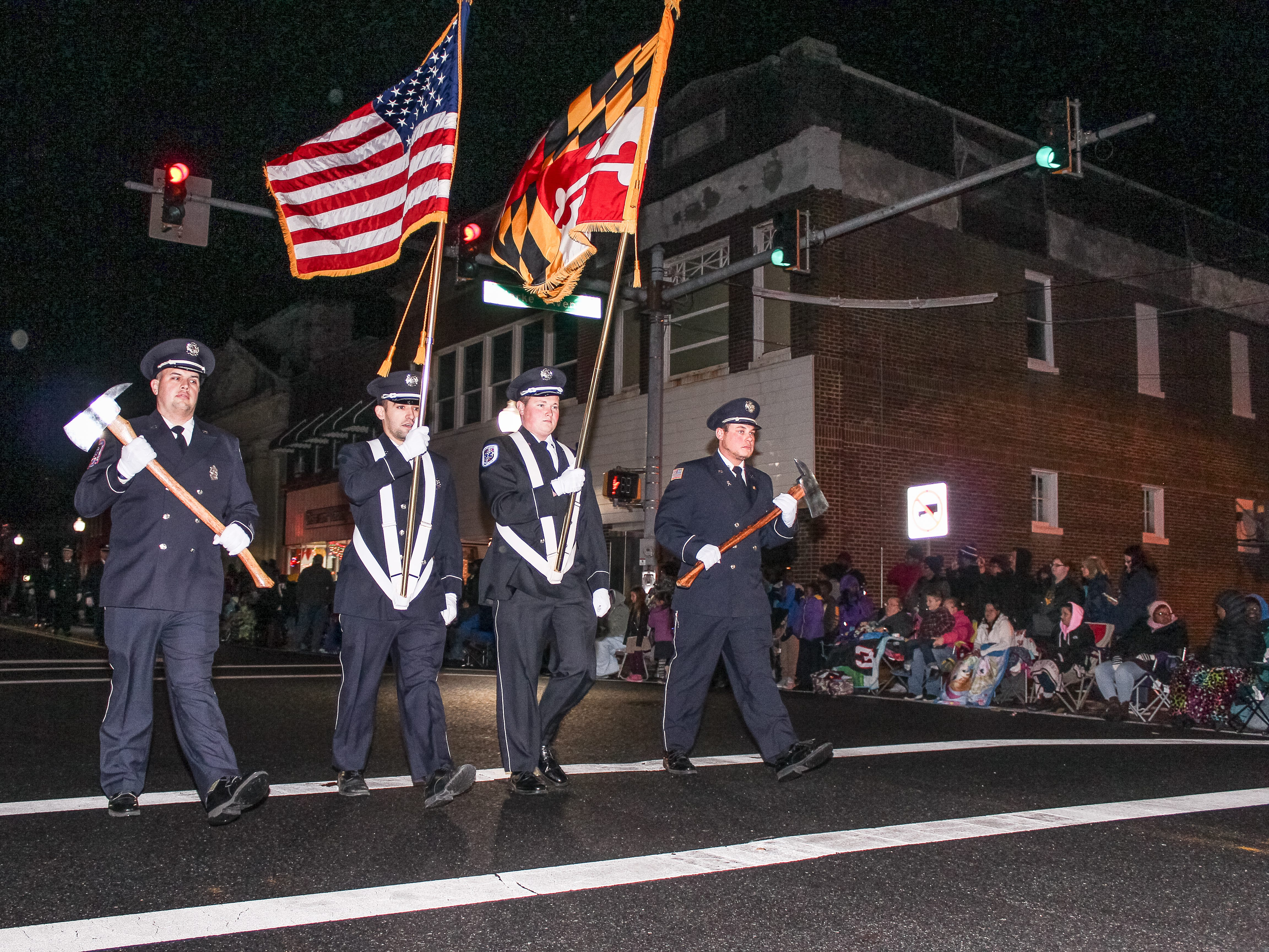 Pocomoke City Fire Company color guard takes part in the town's Christmas parade on Nov. 26, 2018.