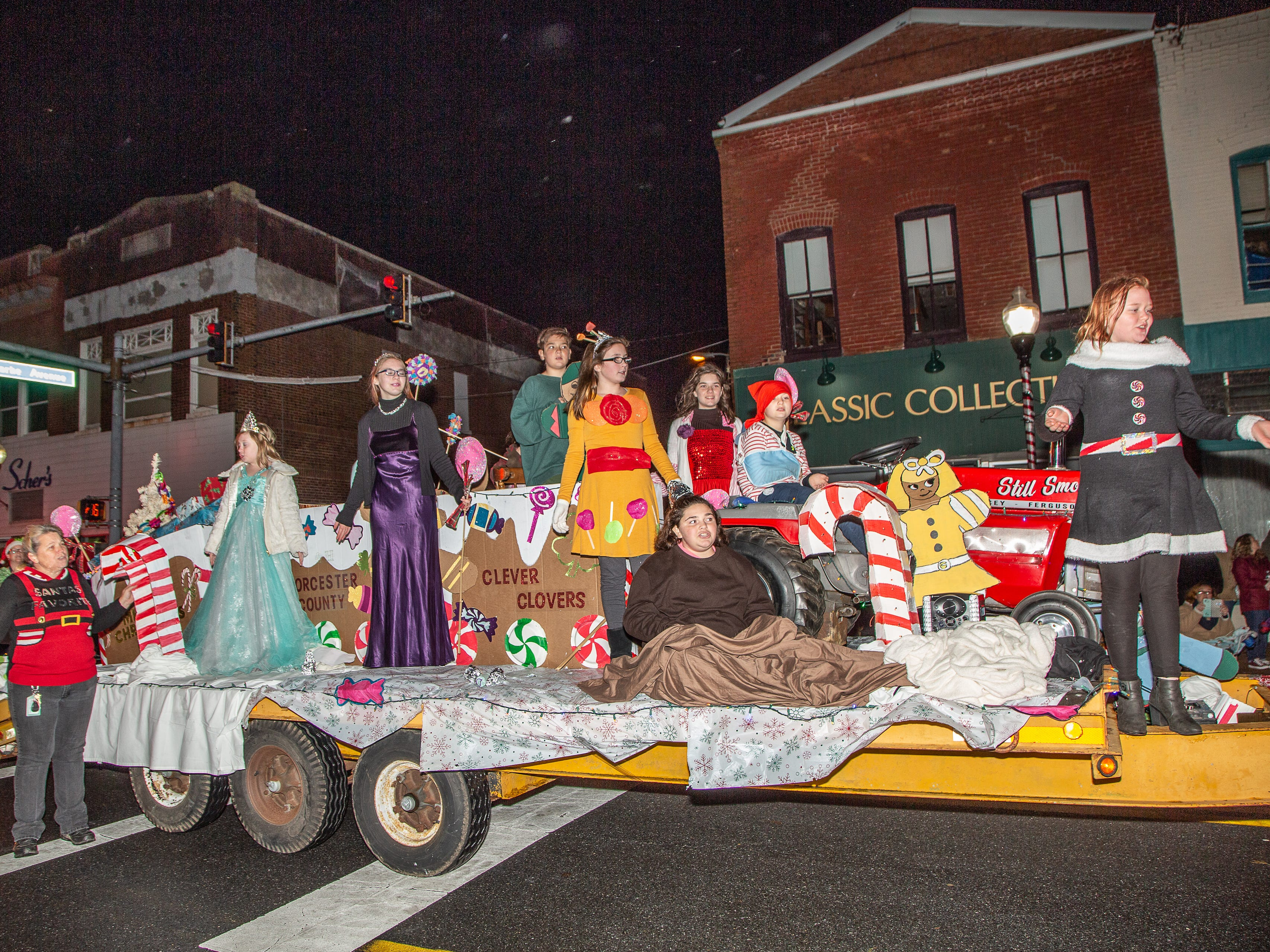The Worcester County 4H participants ride on a float during the Pocomoke City Christmas parade.