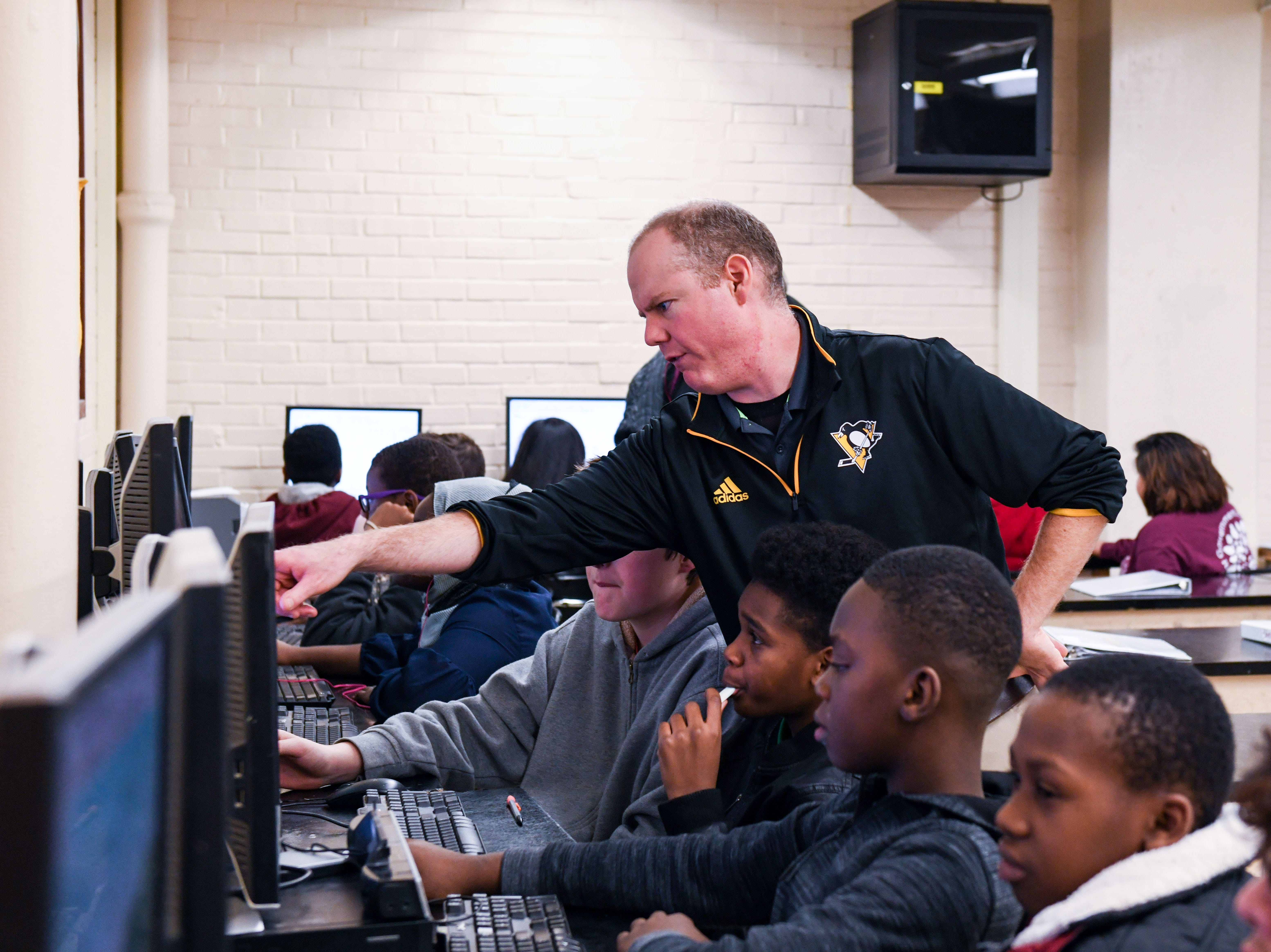 Wicomico Middle School's Jeff Lynd teaches in his classroom on Tuesday, Nov 27, 2018. Lynd donated a kidney to fellow Pittsburgh Penguins fan Kelly Sowatsky less than a month ago.