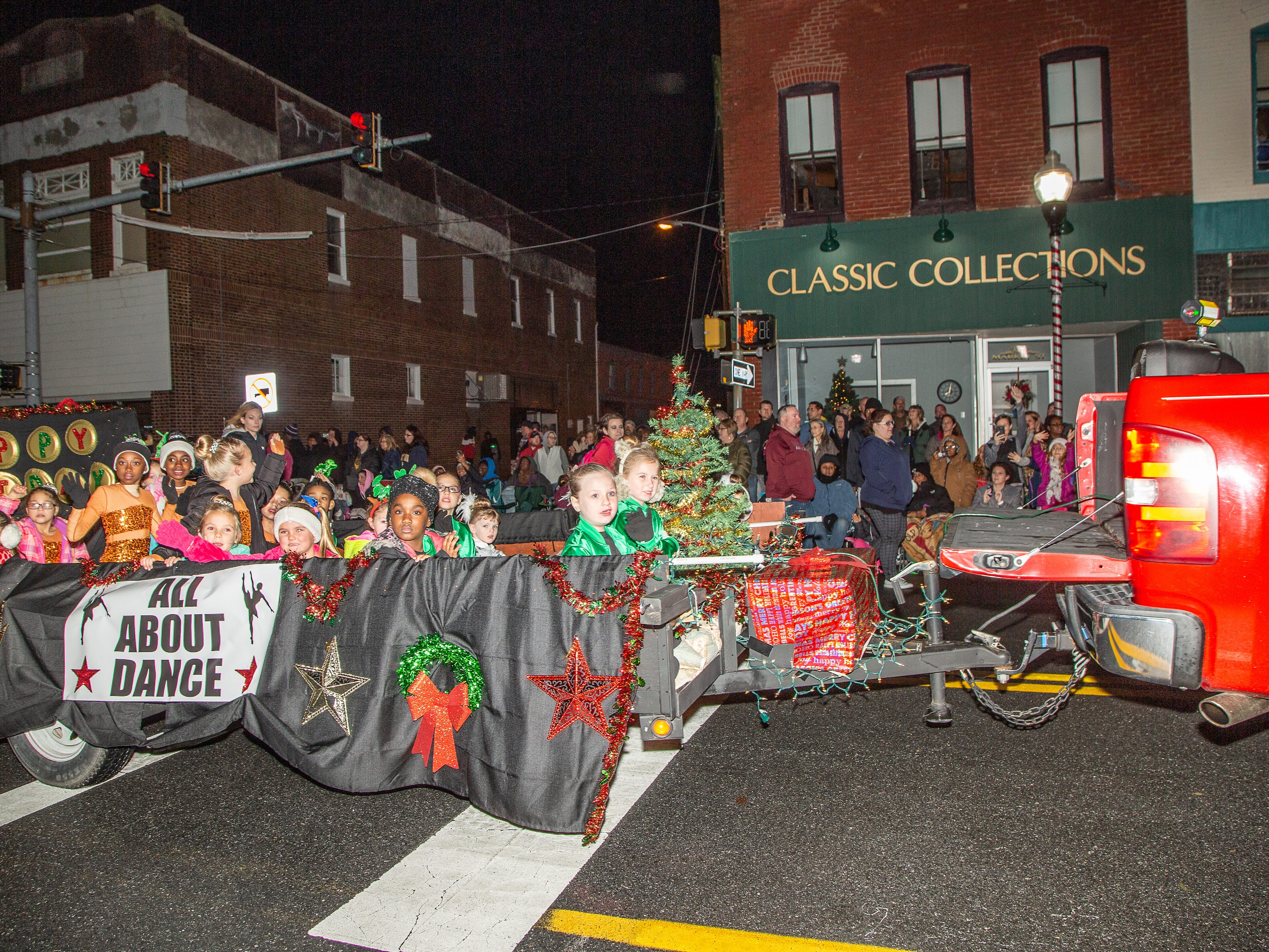 The All About Dance team from Pocomoke rides a float at the annual Christmas parade.