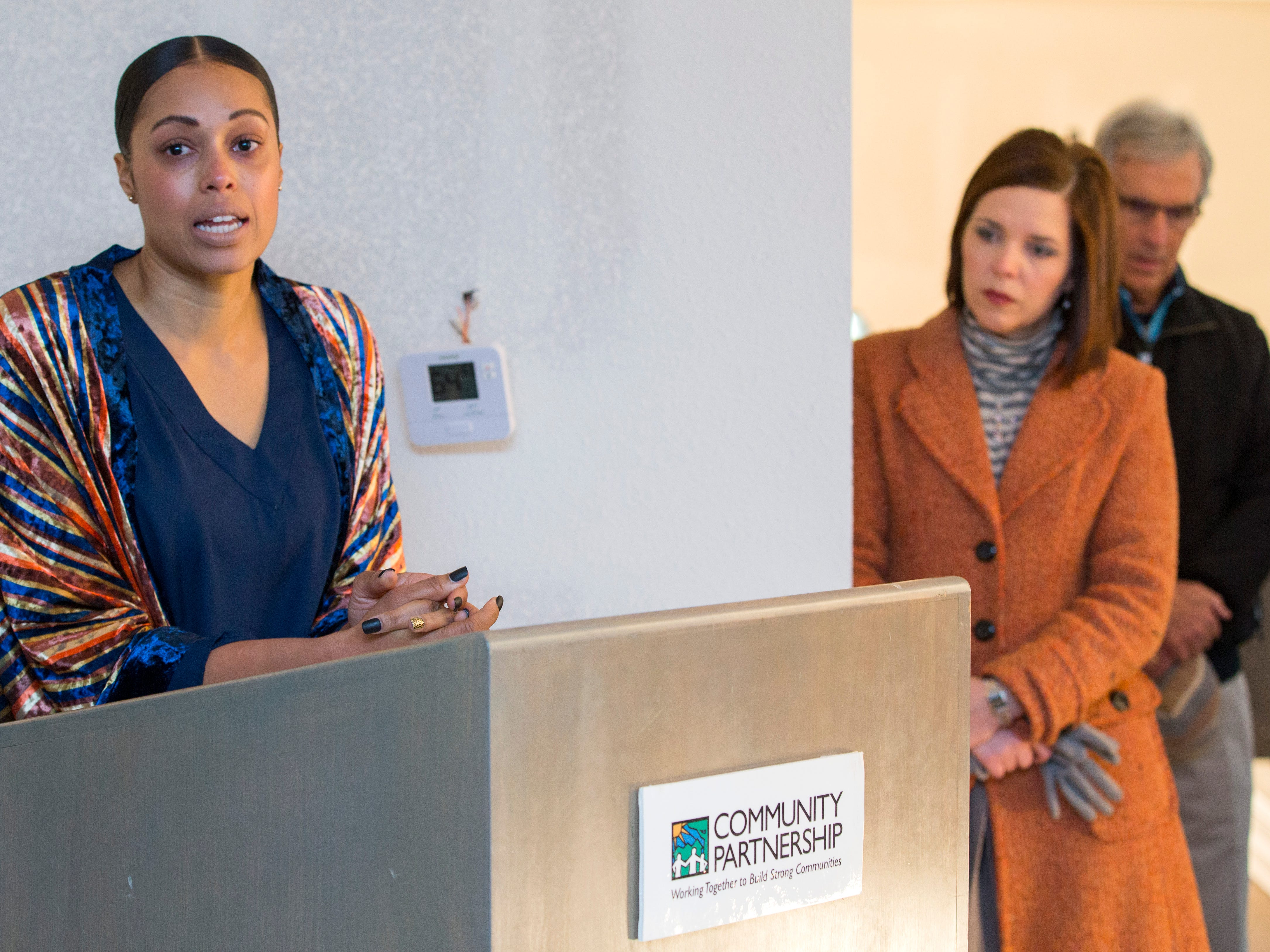 Christina Ford speaks before the ribbon cutting for Marda's House, a transitional home for domestic violence victims, on Tuesday, Nov. 27, 2018.