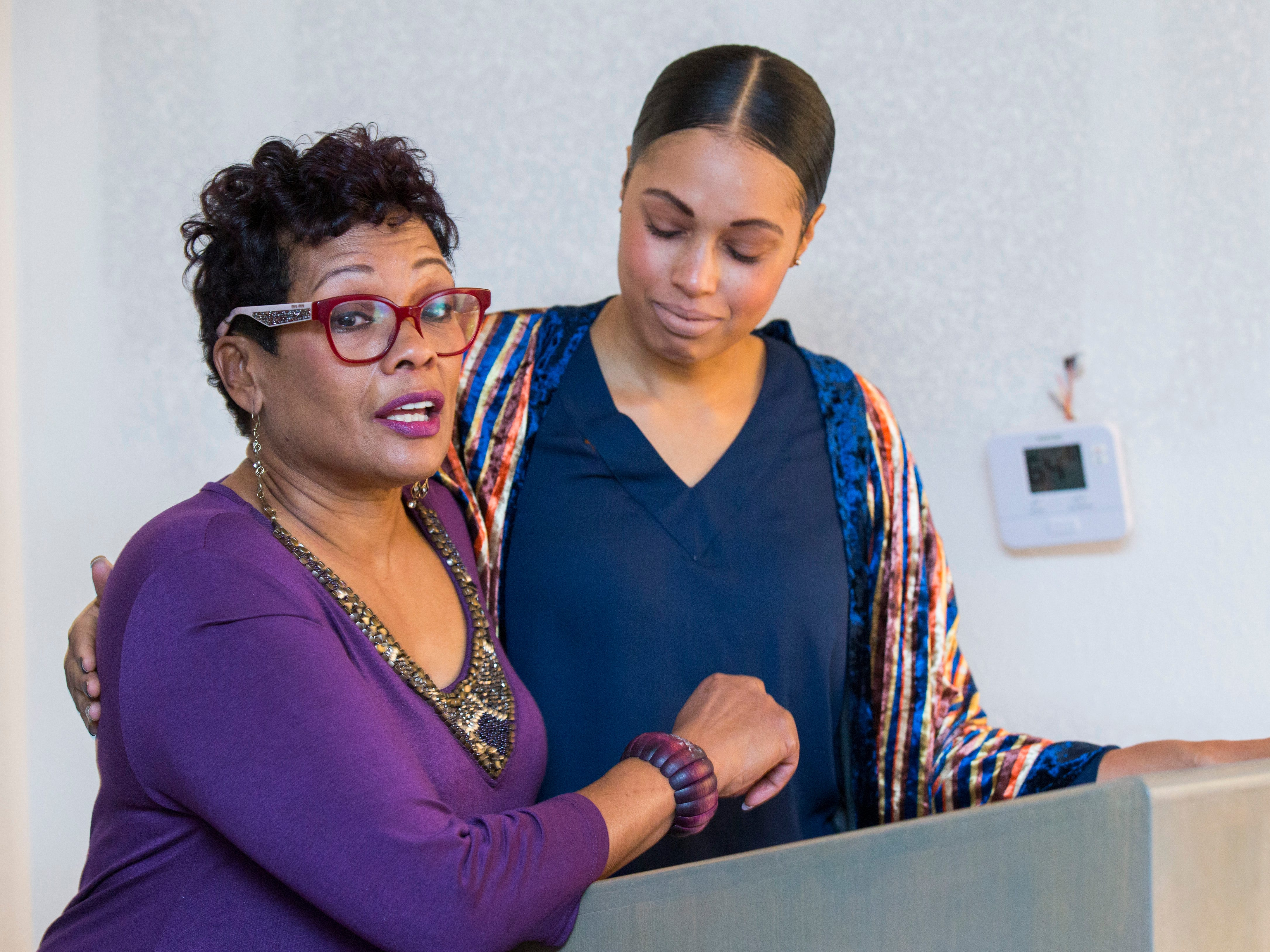 Marda Jackson speaks next to her daughter Christina Ford before the ribbon cutting for Marda's House, a transitional home for domestic violence victims, on Tuesday, Nov. 27, 2018.