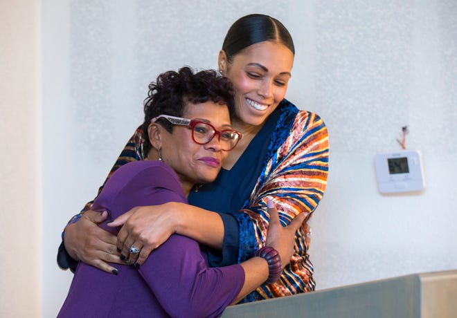 Christina Ford hugs her mom, Marda Jackson, during the ribbon cutting for Marda's House, a transitional home for domestic violence victims, on Tuesday, Nov. 27, 2018.