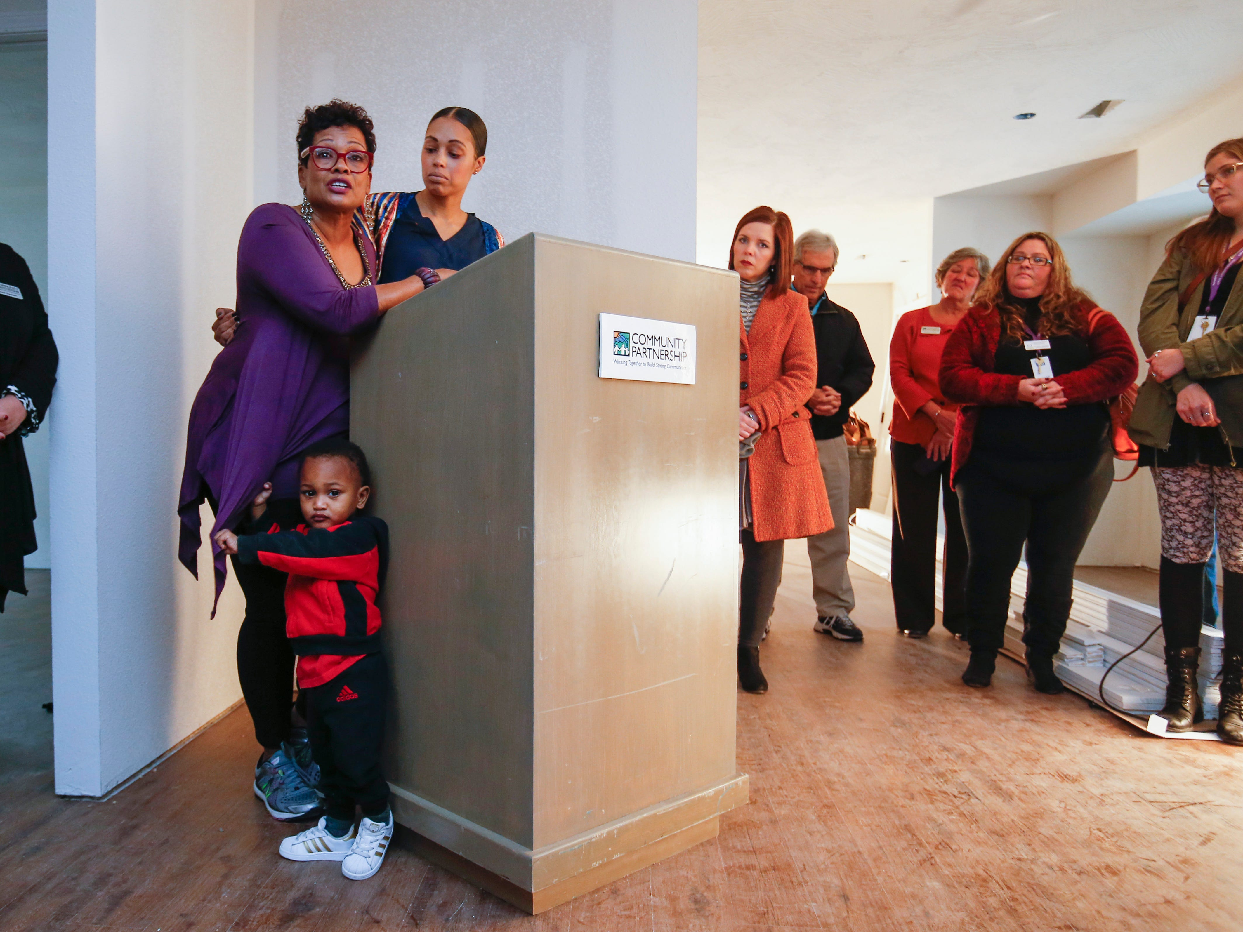 Marda Jackson speaks next to her daughter Christina Ford before the ribbon-cutting for Marda's House, a transitional home for domestic violence victims, on Tuesday, Nov. 27, 2018.