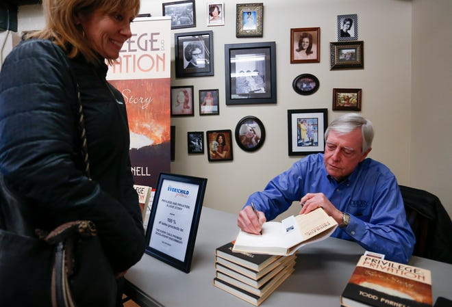 "Todd Parnell signs a copy of his book ""Privilege and Privation: A Love Story"" during a book signing at Mother's Brewing Co. on Tuesday, Nov. 27, 2018. All proceeds from the sale of the $25 books will go toward the Every Child Promise Scholarship Endowment Fund."