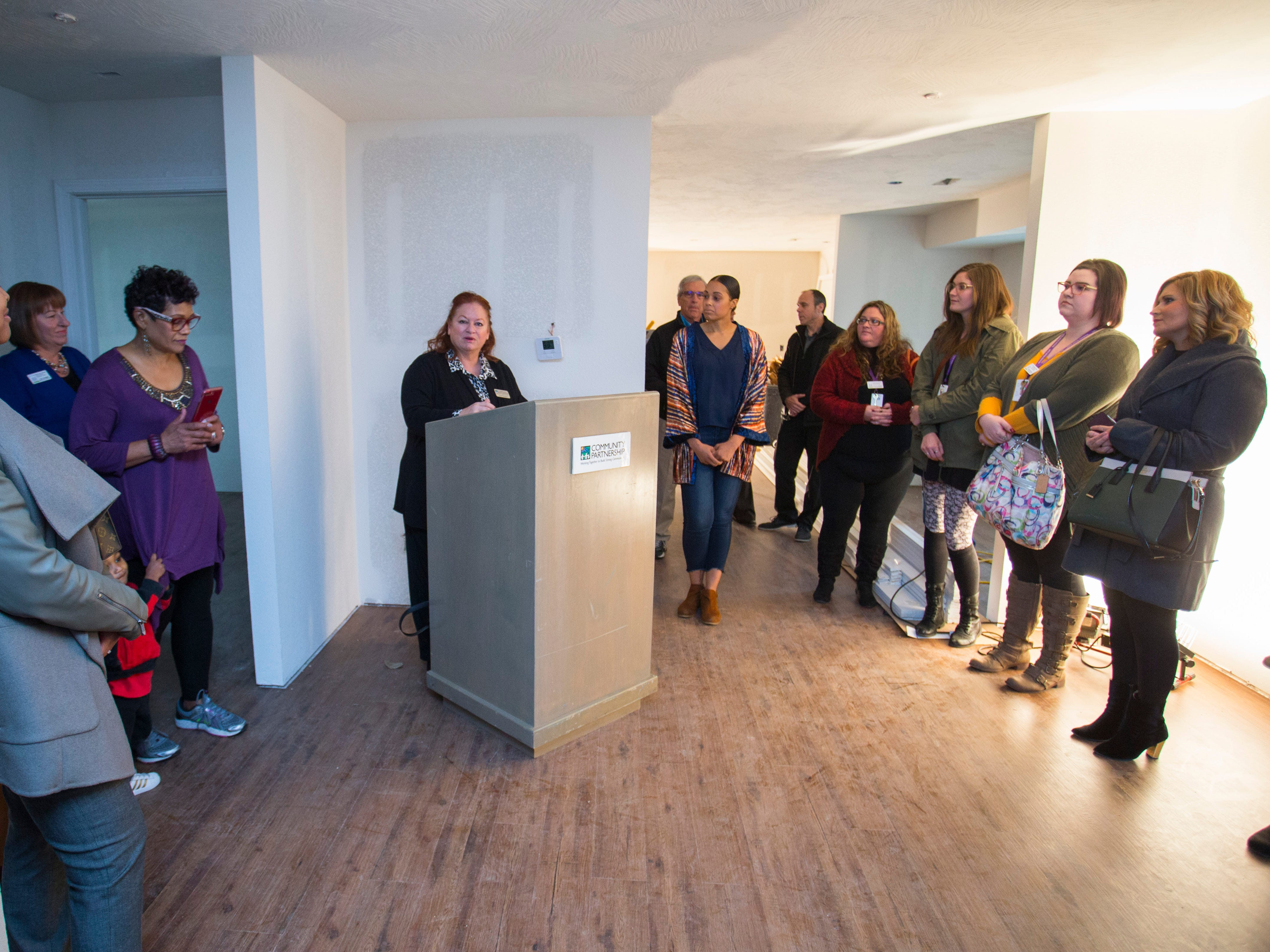 Janet Dankert with Community Partnership of the Ozarks speaks before the ribbon-cutting for Marda's House, a transitional home for domestic violence victims, on Tuesday, Nov. 27, 2018.