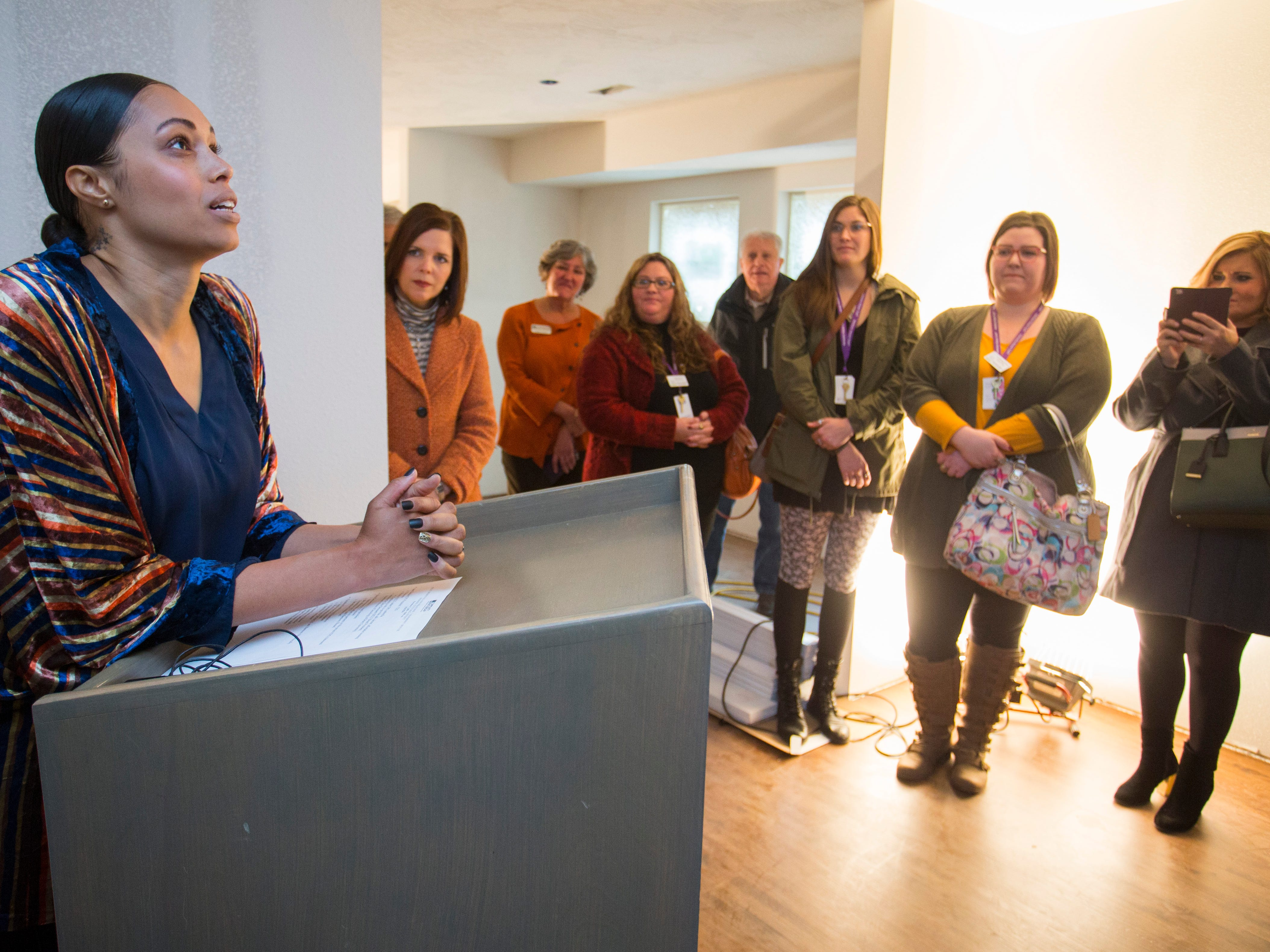 Christina Ford becomes emotional as she speaks about the opening of Marda's House, a transitional home for domestic violence victims, on Tuesday, Nov. 27, 2018.