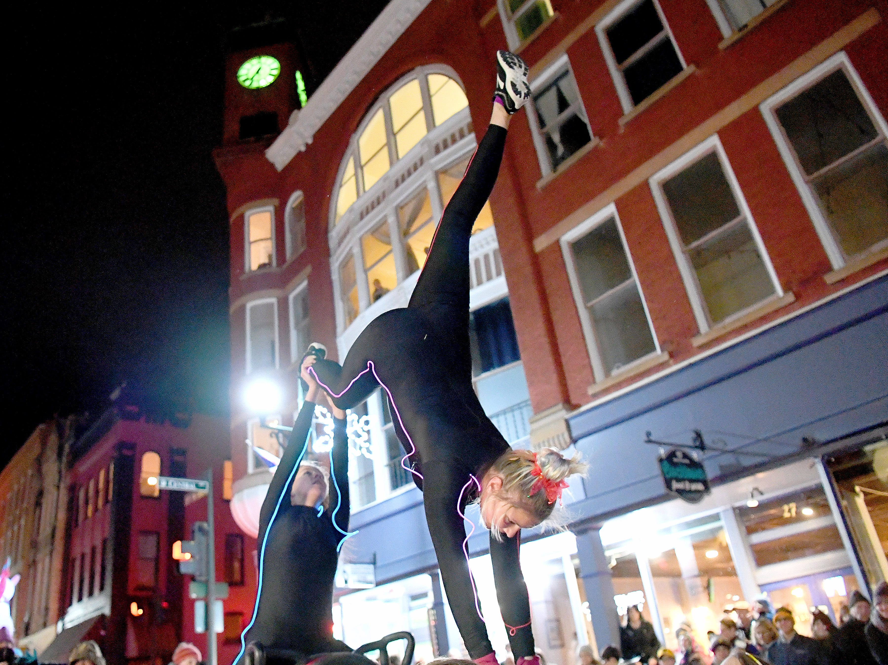 Gymnastic style moves performed on a float in the Staunton Christmas Parade on Monday, Nov. 26, 2018.