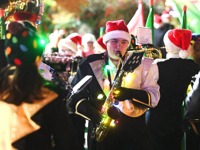 Members of Buffalo Gap High School's marching band rehearse together while waiting for the Staunton Christmas Parade to begin on Monday, Nov. 26, 2018.