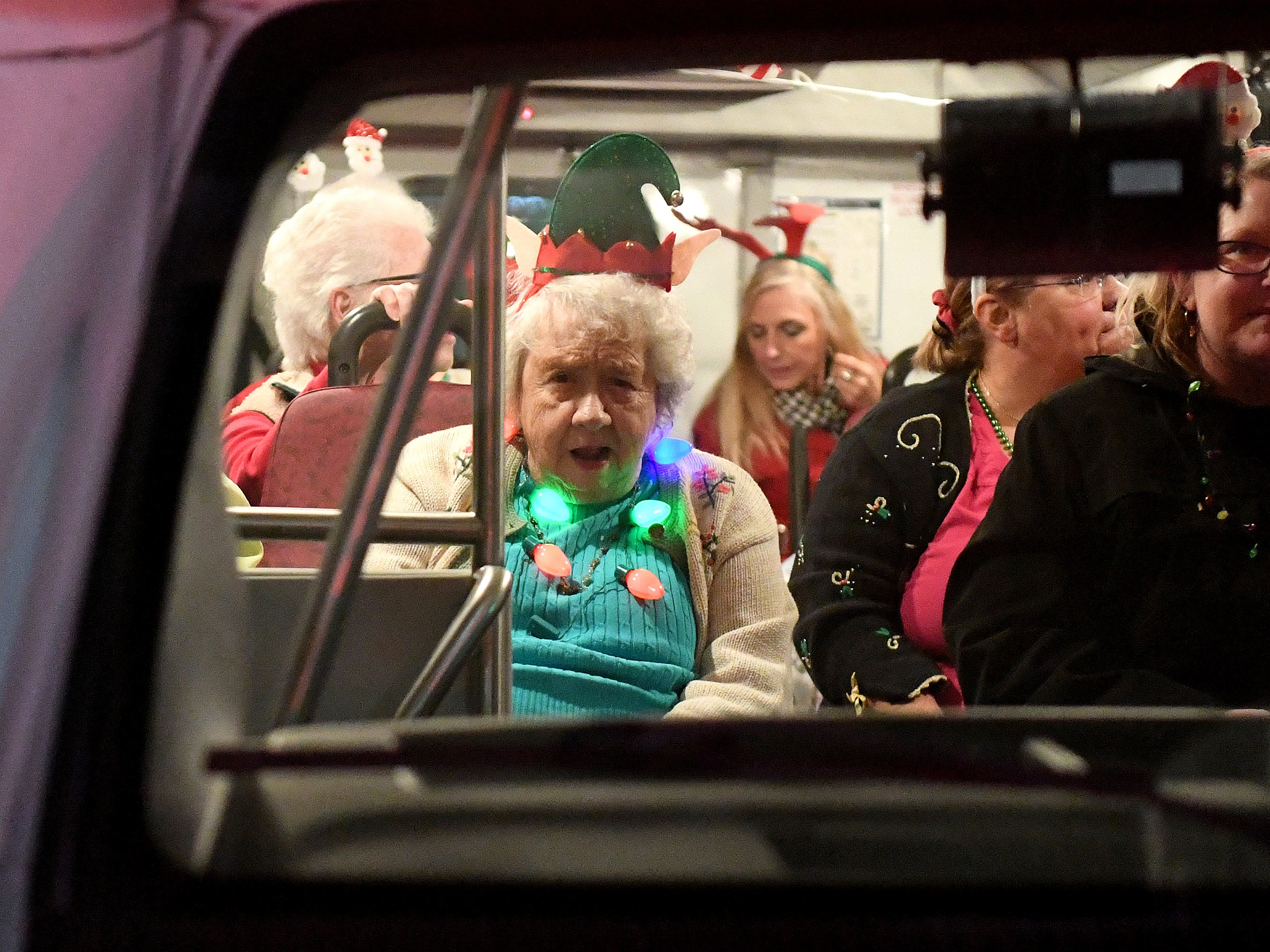 A lady rides in the parade inside a bus during the Staunton Christmas Parade on Monday, Nov. 26, 2018.