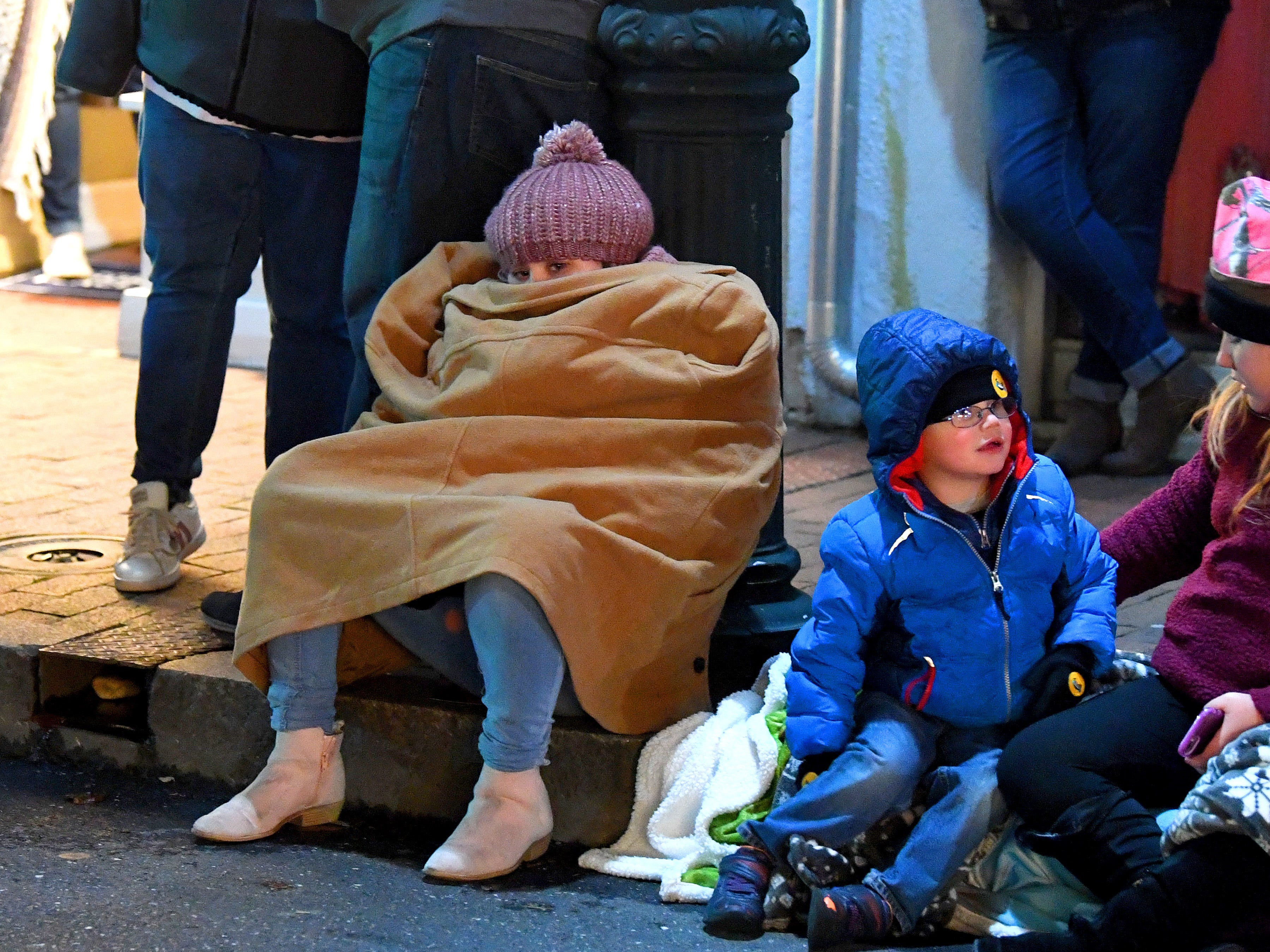 One young parade-goer is bundled up to stay warm while watching the Staunton Christmas Parade on Monday, Nov. 26, 2018.