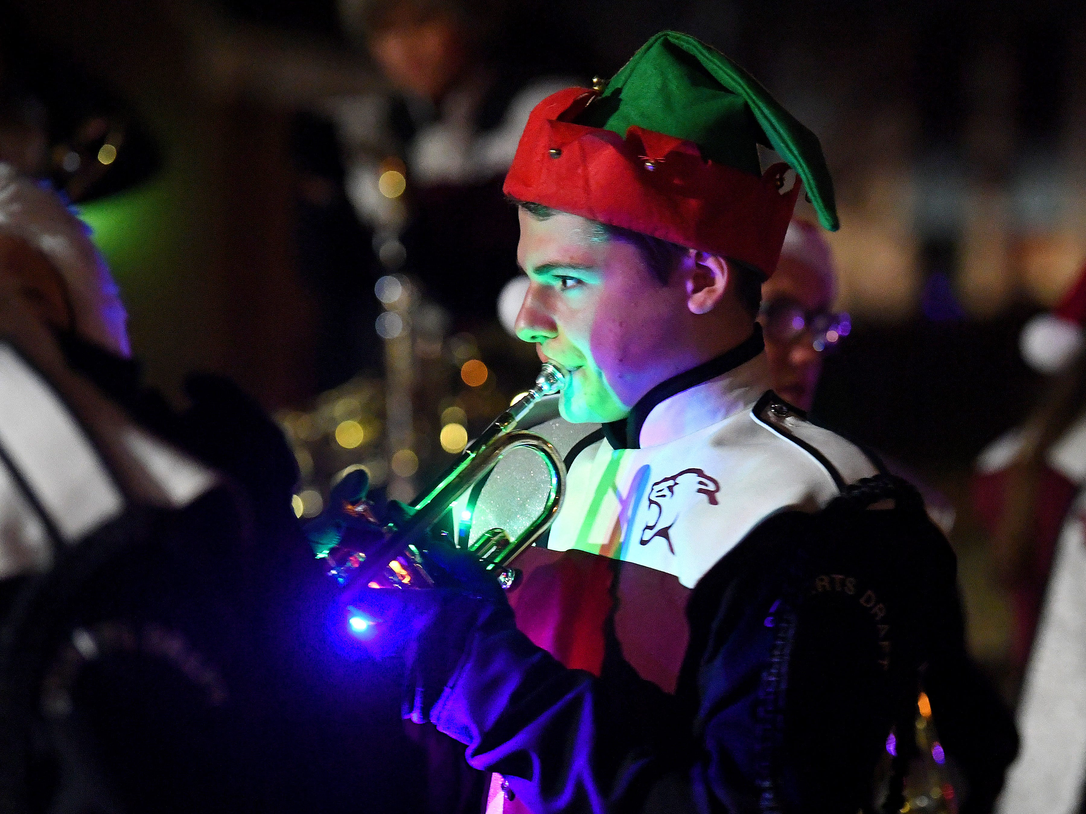 Members of Stuarts Draft High School's marching band rehearse together while waiting for the Staunton Christmas Parade to begin on Monday, Nov. 26, 2018.