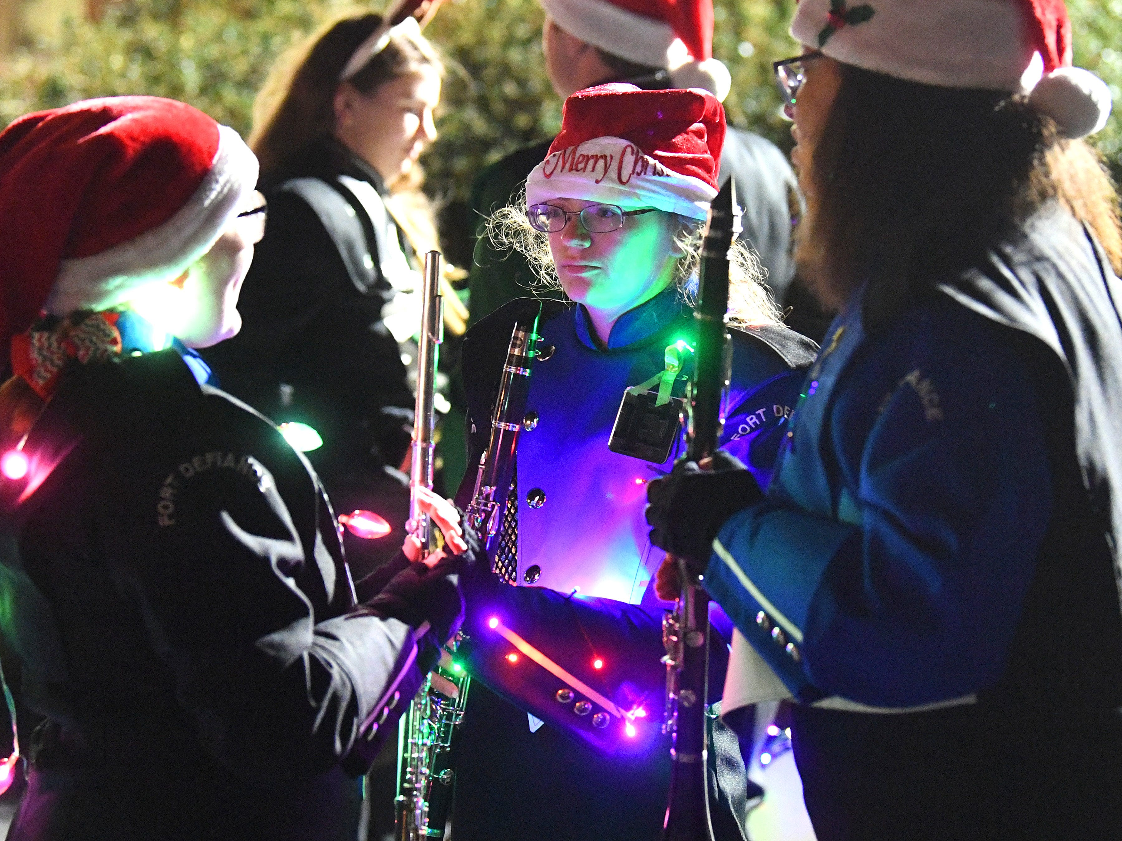 Members of Fort Defiance High School's marching band rehearse together while waiting for the Staunton Christmas Parade to begin on Monday, Nov. 26, 2018.