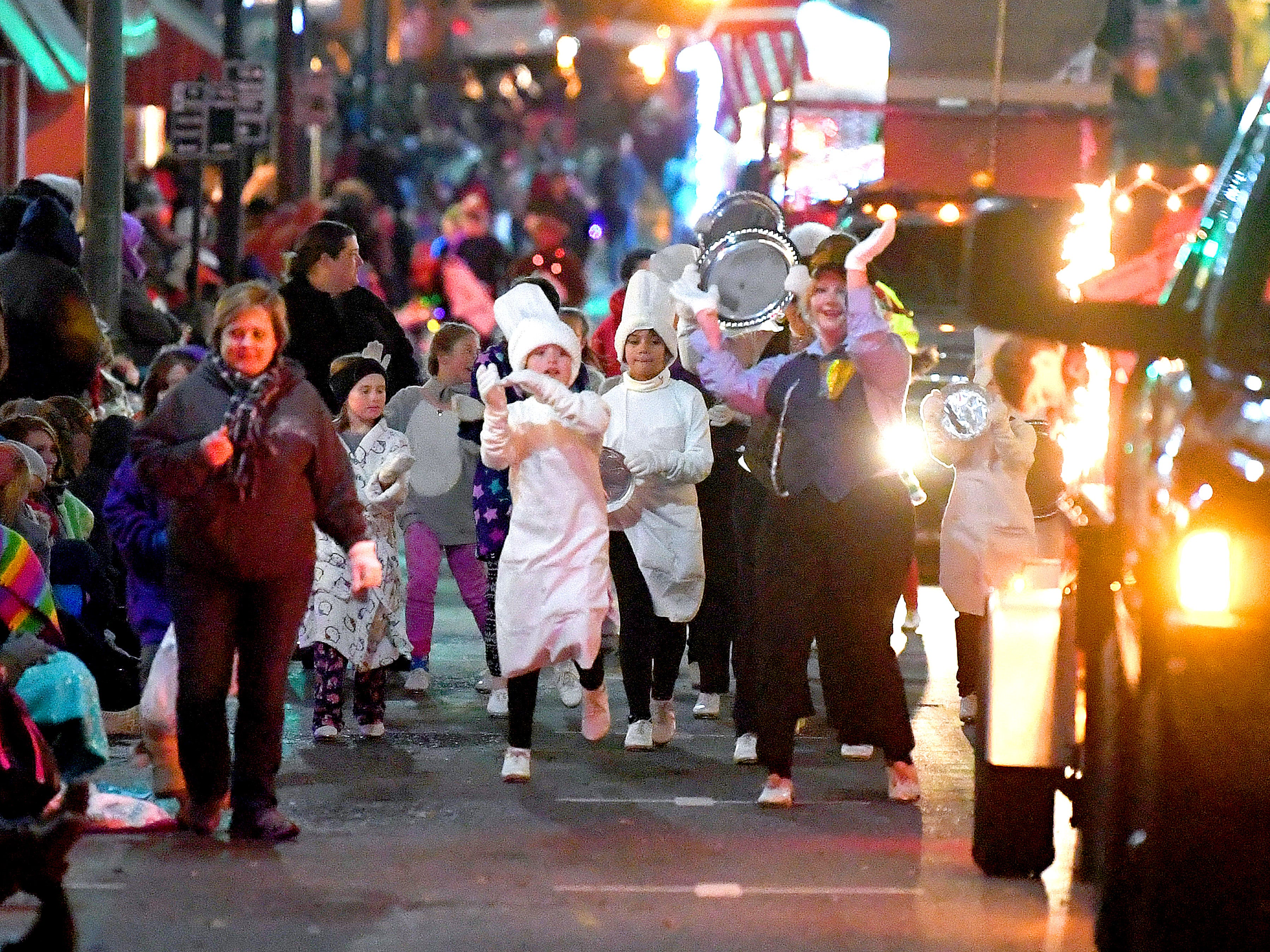 Dancers perform while walking the route during the Staunton Christmas Parade on Monday, Nov. 26, 2018.