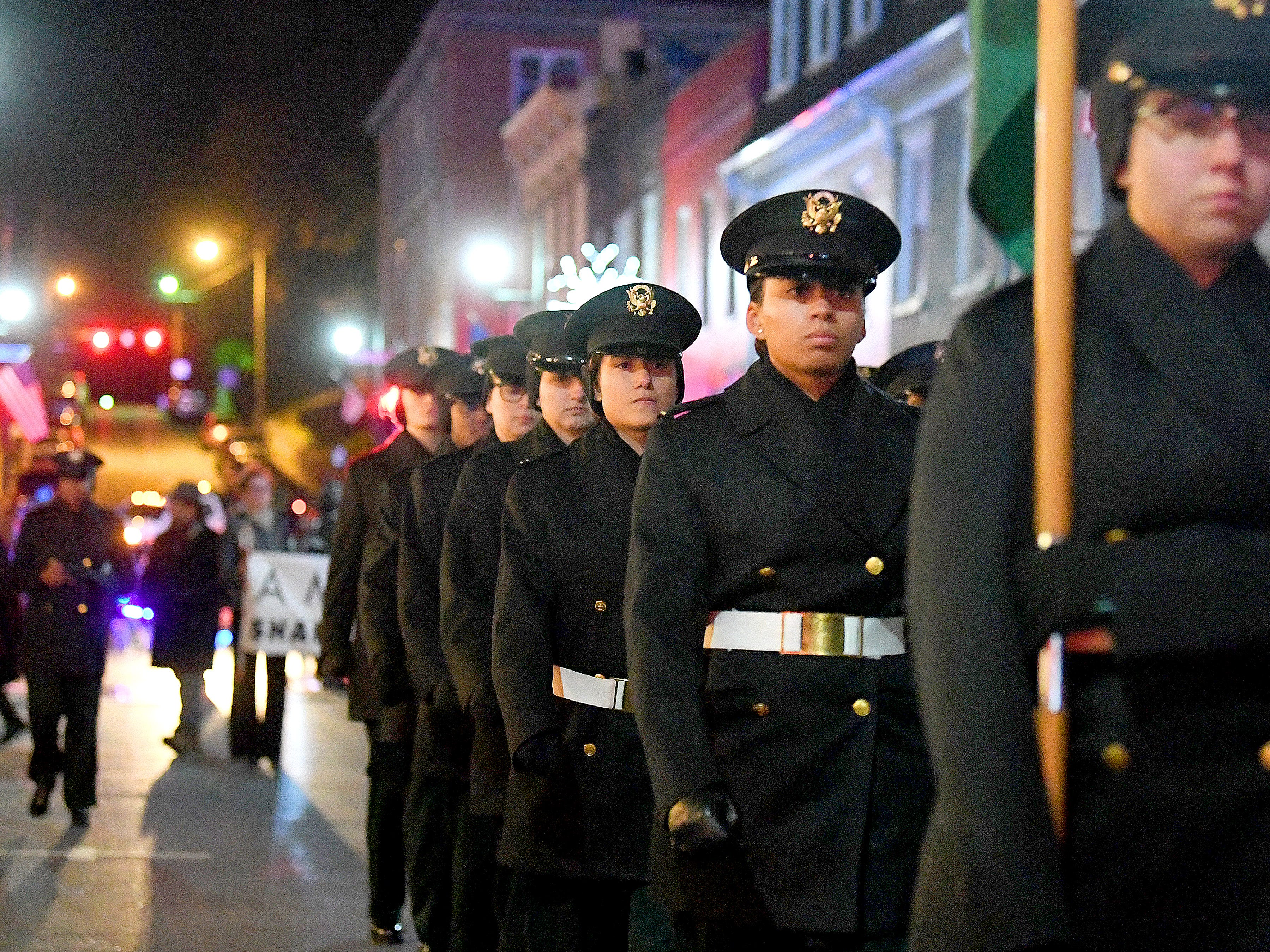 Cadets from Mary Baldwin University's Virginia Women's Institute for Leadership march during the Staunton Christmas Parade on Monday, Nov. 26, 2018.