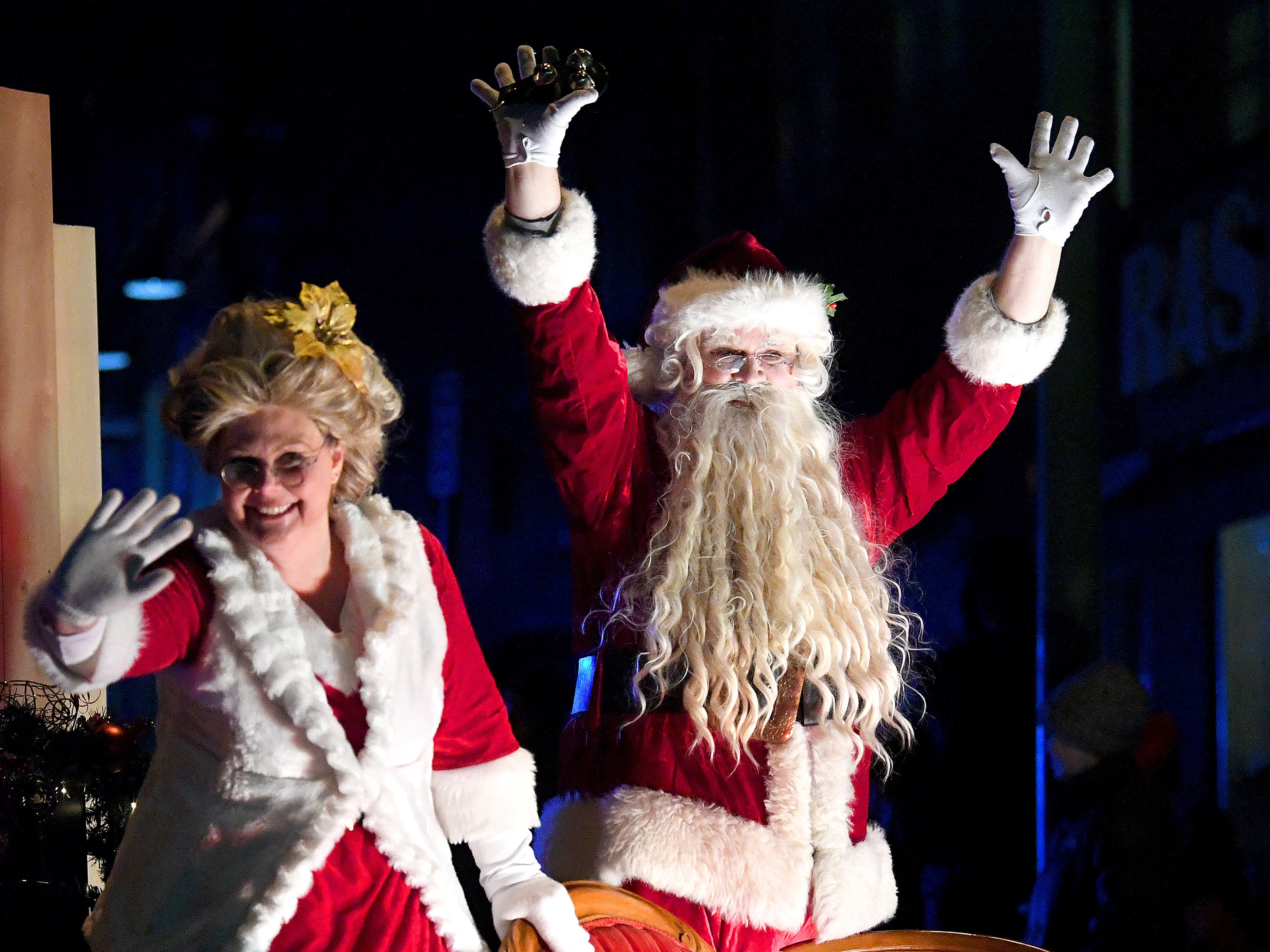 Santa Claus and Mrs. Claus wave to the crowd from their float at the end of the Staunton Christmas Parade on Monday, Nov. 26, 2018.