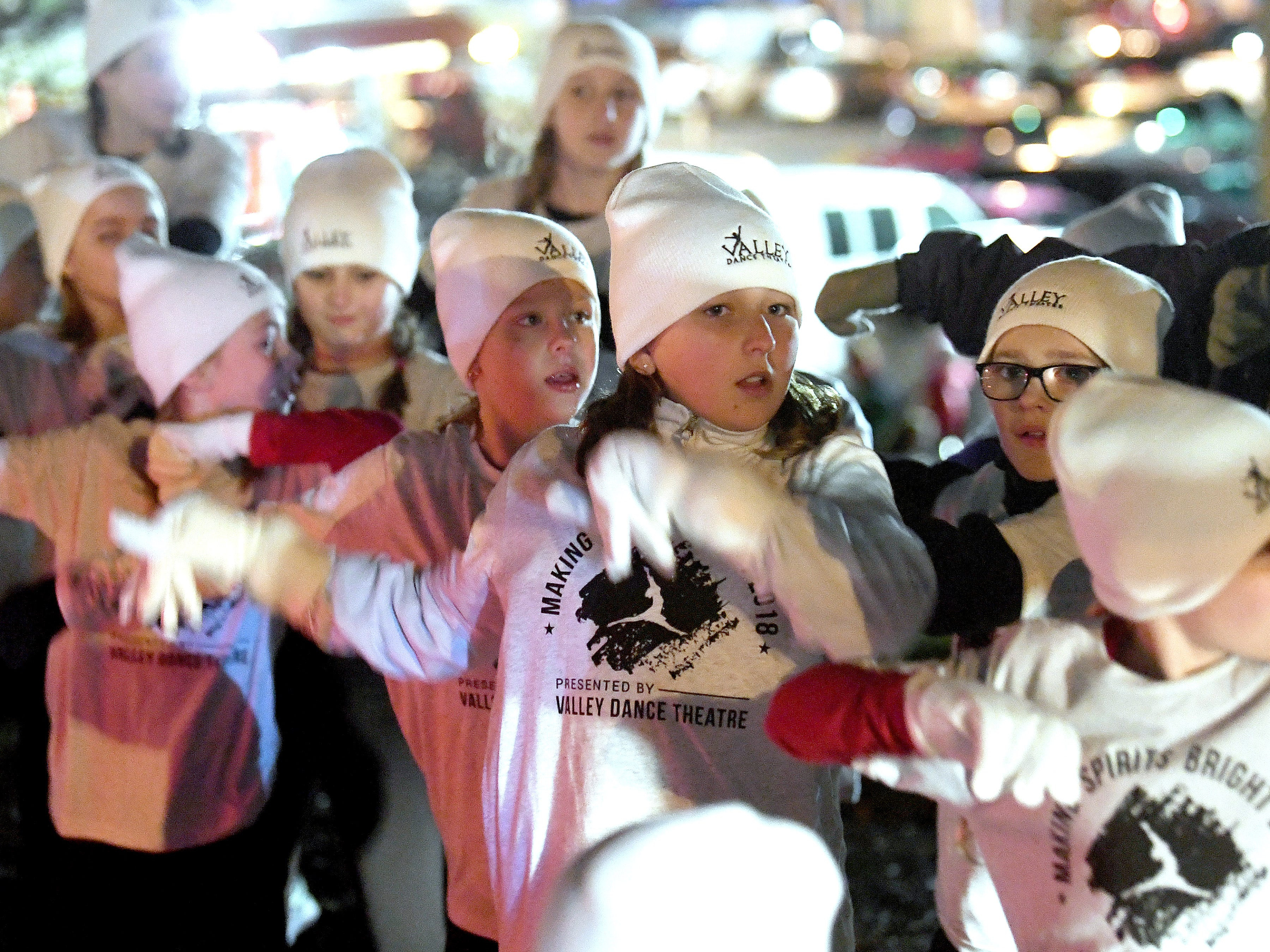 Dancers rehearse their moves while waiting for the Staunton Christmas Parade to begin on Monday, Nov. 26, 2018.