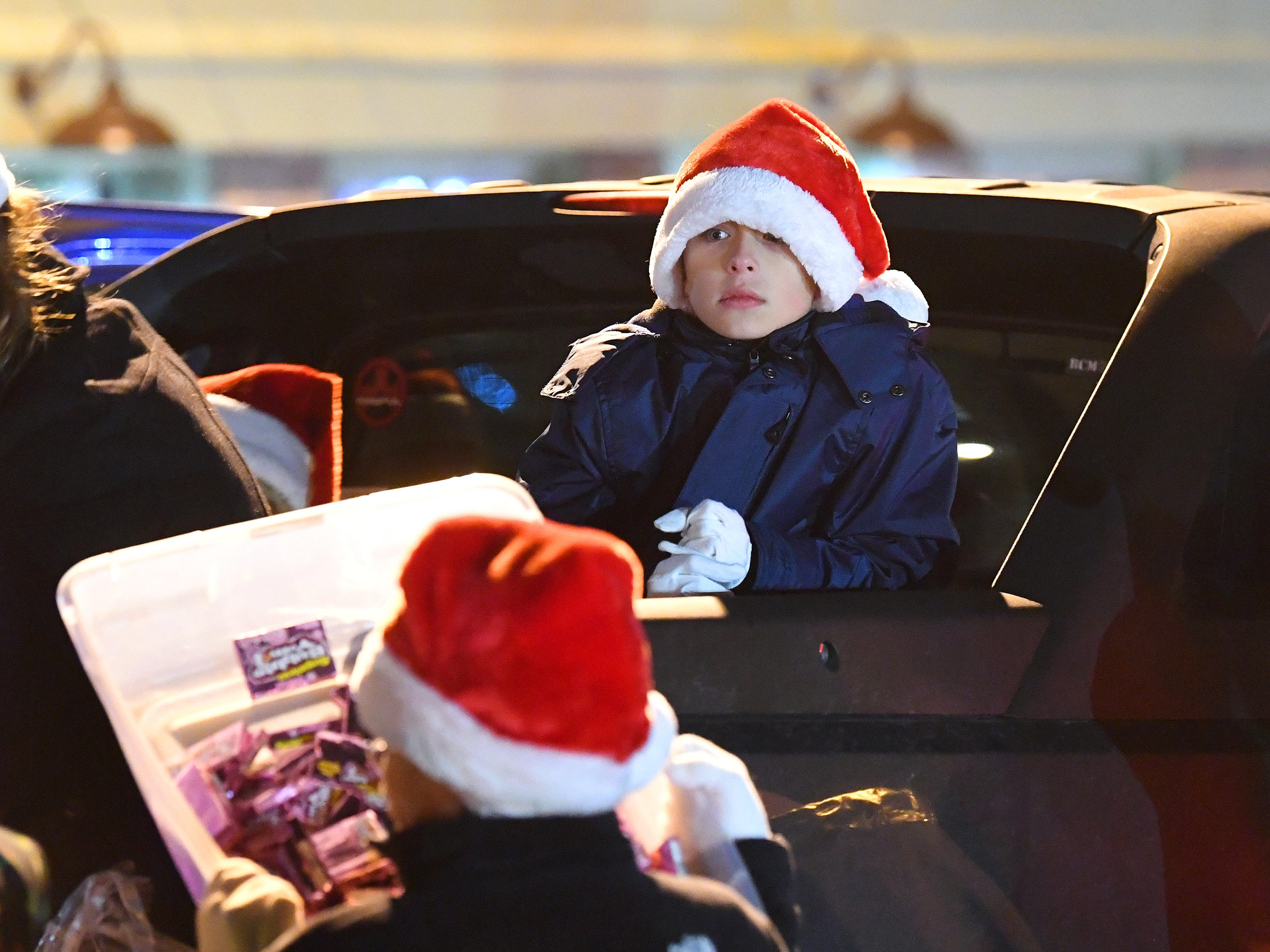 A young parade participant waits with others on a float for the Staunton Christmas Parade to begin on Monday, Nov. 26, 2018.