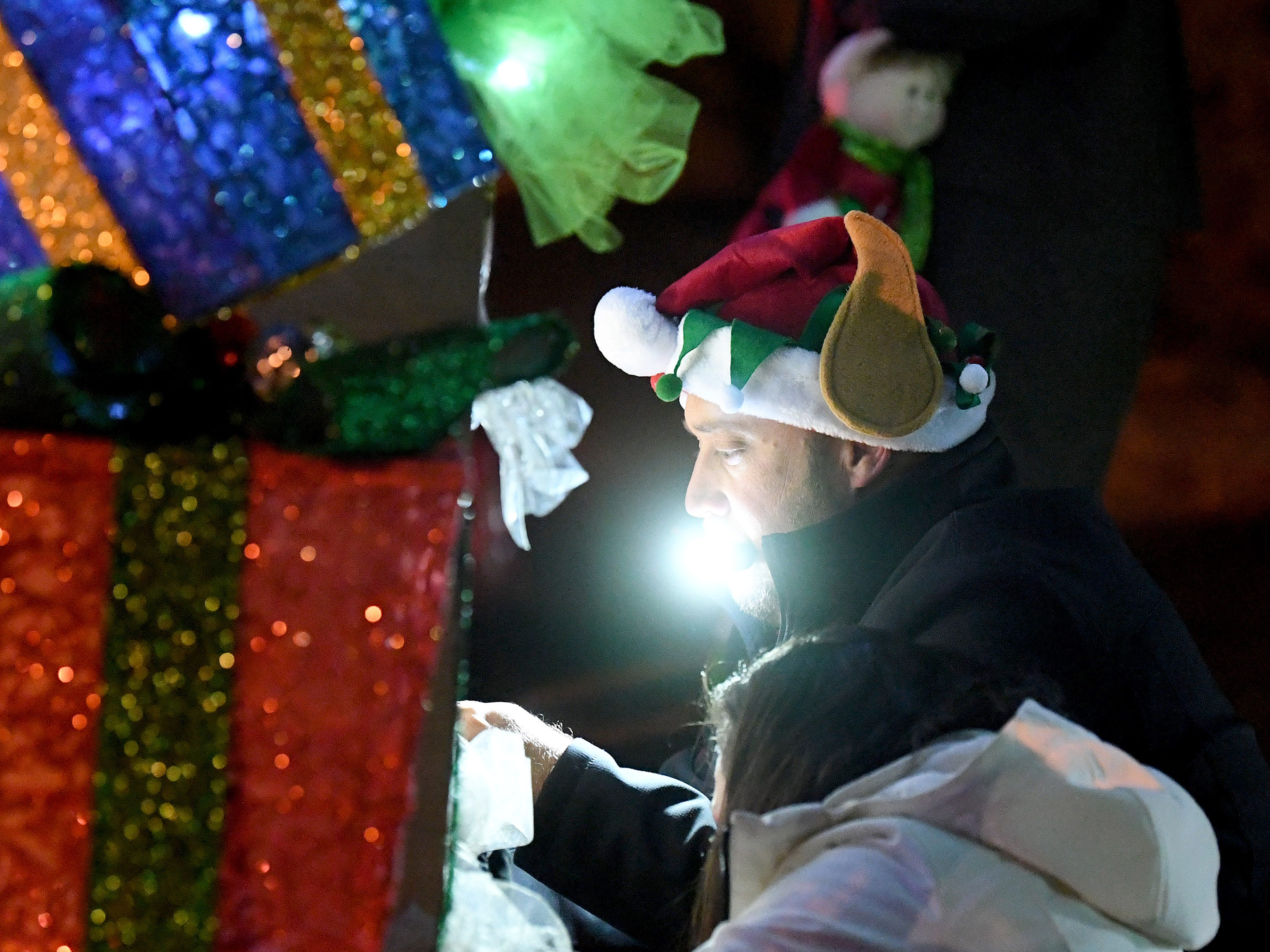 A parade participant helps decorate a float before the start of the Staunton Christmas Parade on Monday, Nov. 26, 2018.