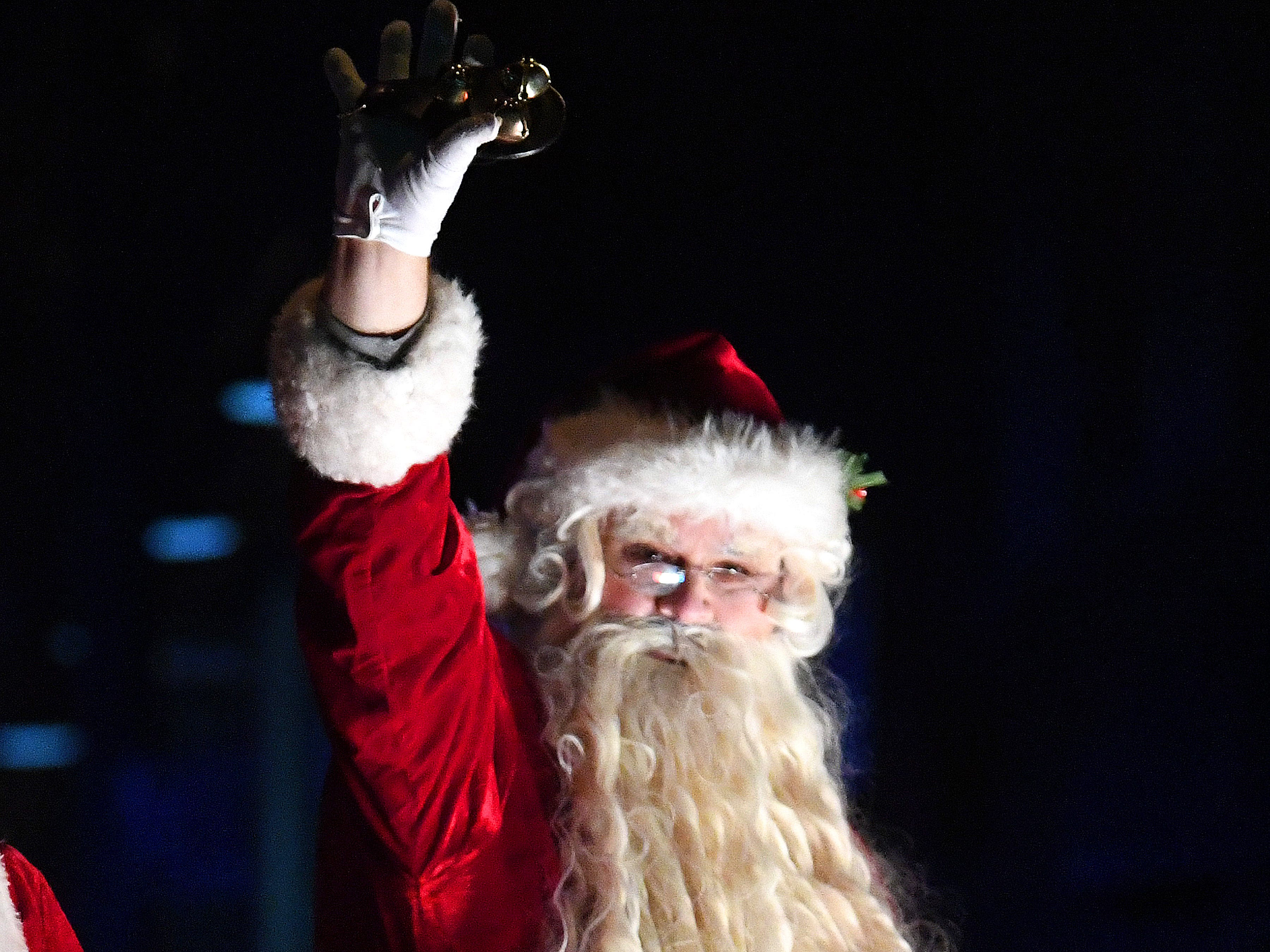 Santa waves to the crowd from his float at the end of the Staunton Christmas Parade on Monday, Nov. 26, 2018.