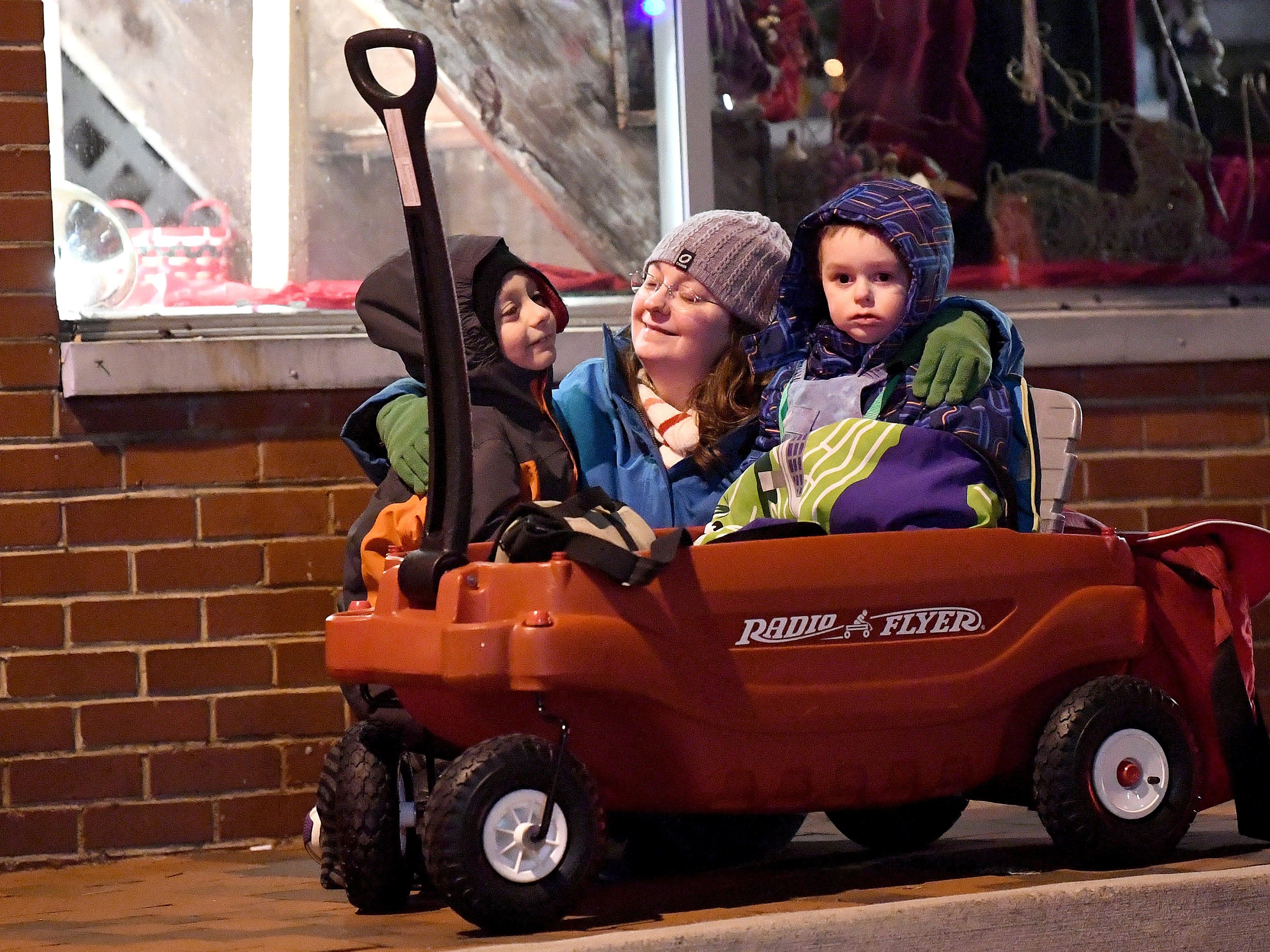 A family watches the Staunton Christmas Parade on Monday, Nov. 26, 2018.