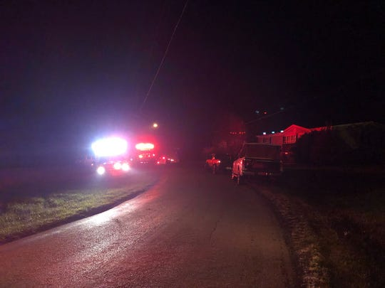 Fire and police vehicles block Stuples Hollow Road late Monday night at the scene of a Craigsville fire.