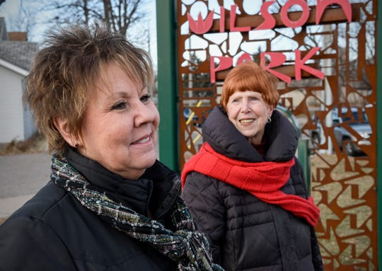 Joan Jaye and Carolyn Garven talk about the upcoming East Side Visioning session on Saturday. They stood Tuesday, Nov. 27, by the Northeast-Wilson Park Neighborhood gateway sign.