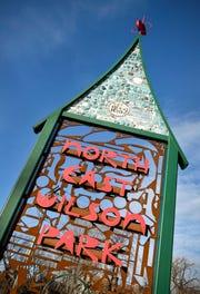 A custom sculpture marks the Northeast-Wilson Park Neighborhood shown Tuesday, Nov. 27, in St. Cloud.