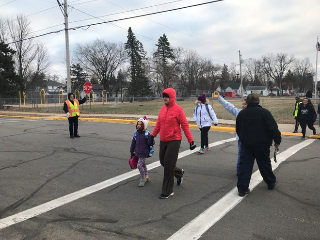 Agnes Kowalski helps children cross the street at Jefferson Elementary School after school. Kowalski is one of 170 crossing guards running for America's Favorite Crossing guards.