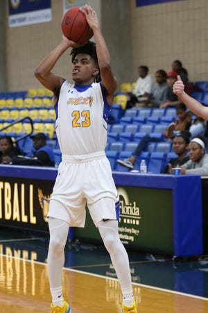 TCC guard Jalen Dalcourt shoots for three against the Combine Academy Warriors at the Eagledome, Monday, Nov. 26, 2018.