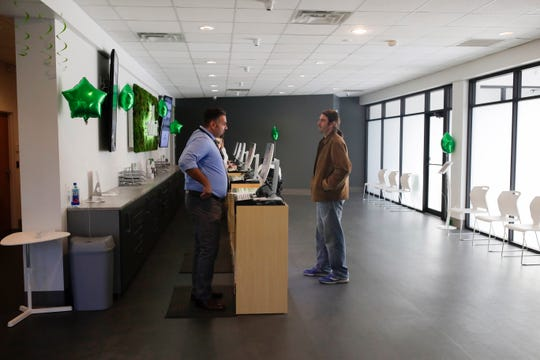 Brent Webb, right, gets help from Dispensary Ambassador Derrick Koelsch at the brand new Curaleaf medical marijuana dispensary at 1345 Thomasville Road, Tallahassee, Tuesday, Nov. 27, 2018.