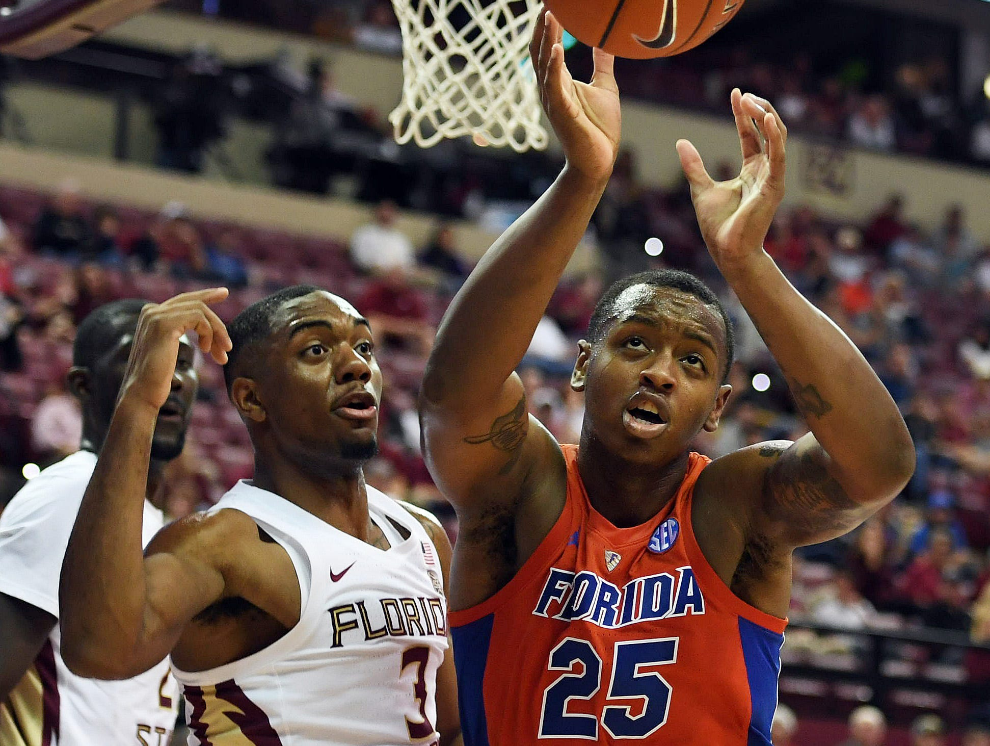 Nov 6, 2018; Tallahassee, FL, USA; Florida State Seminoles guard Trent Forrest (3) and Florida Gators forward Keith Stone (25) fight for a rebound during the first half at Donald L. Tucker Center. Mandatory Credit: Melina Myers-USA TODAY Sports