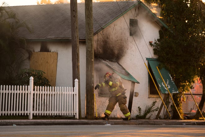 Martin County Fire Rescue personnel respond to a fire at a home near the corner of Southeast Martin Luther King Jr. Boulevard and Southeast Lake Street on Tuesday, Nov. 27, 2018, in Stuart.