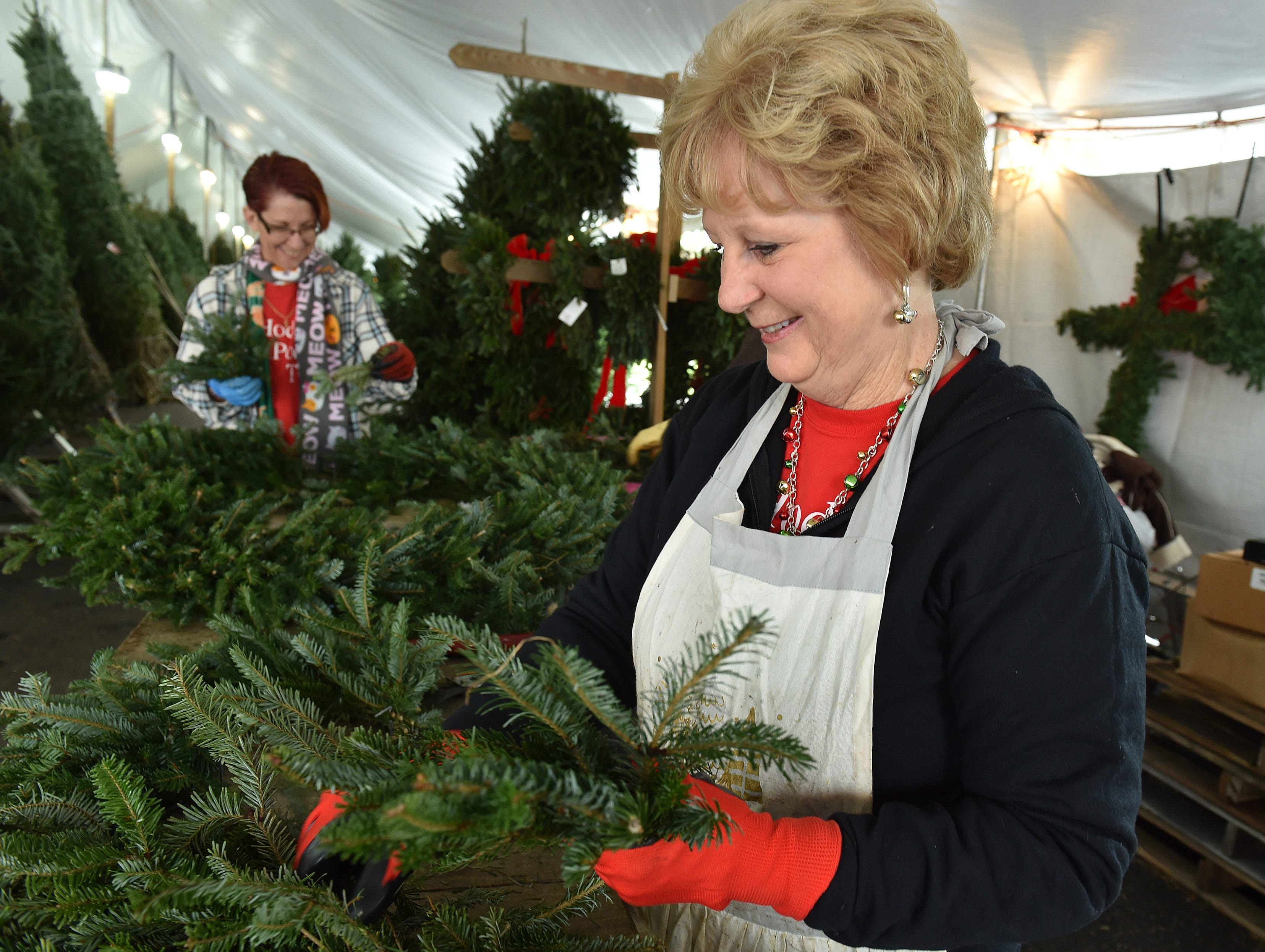 Christmas Tree shopping fun on Tuesday, Nov. 27, 2018, at Hodge Podge Trees in the Kmart Plaza parking lot in the 1600 block of US 1 in Vero Beach.