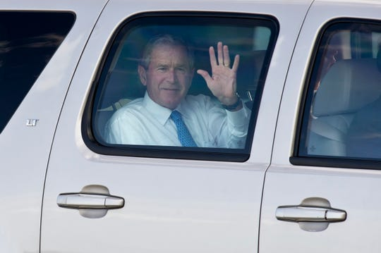Former president George W. Bush waves to a crowd of about 20 onlookers Monday, Feb. 3, 2014, at the Vero Beach Municipal Airport, where he arrived ahead of his speaking engagements at the Riverside Theatre. The 43rd president was the headliner for Riverside's Distinguished Lecturer Series in 2014.