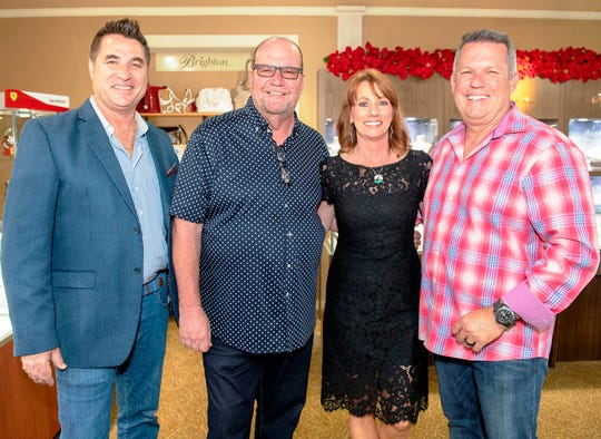 From left, Joe Martin owner of LouRonzo's, John and Liliann Petersen and Rick Wilson, owner of The Gafford at the Argento Jewelry event to benefit Catch the Wave of Hope.  Photo credit 3: Liz McKinley Photo caption 3: Lifeguard President Tony Barletta and members Mark Robitaille and Michael Huston at the Argento Jewelry event to benefit Catch the Wave of Hope