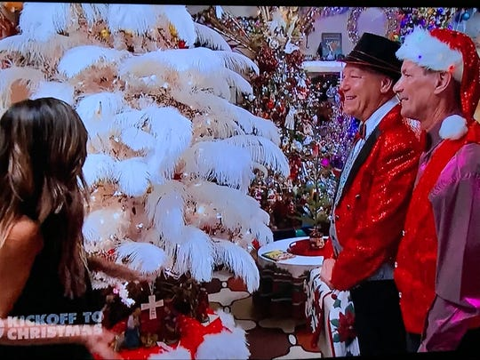 """JW Salveson and Jerome Sangalli talk to host Taniya Nayak about a tree inspired by pianist Liberace during the Monday episode of """"The Great Christmas Light Fight."""""""