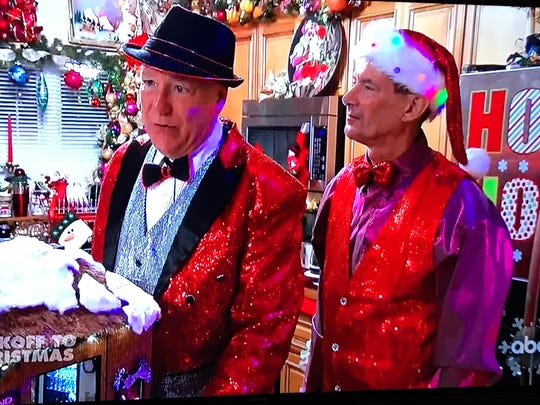 """JW Salveson and Jerome Sangalli talk with Taniya Nayak, host of """"The Great Christmas Light Fight,"""" in their kitchen during Monday's episode of the show."""