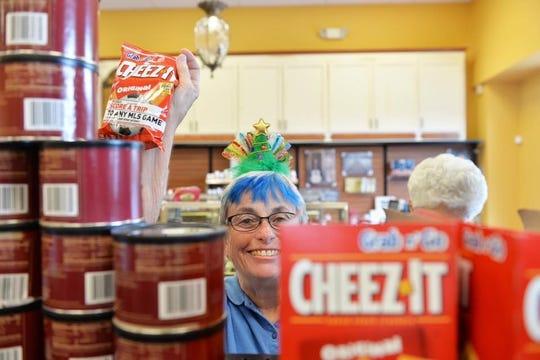 Pilot Member Charlene Moses picks up some goodies for seniors.